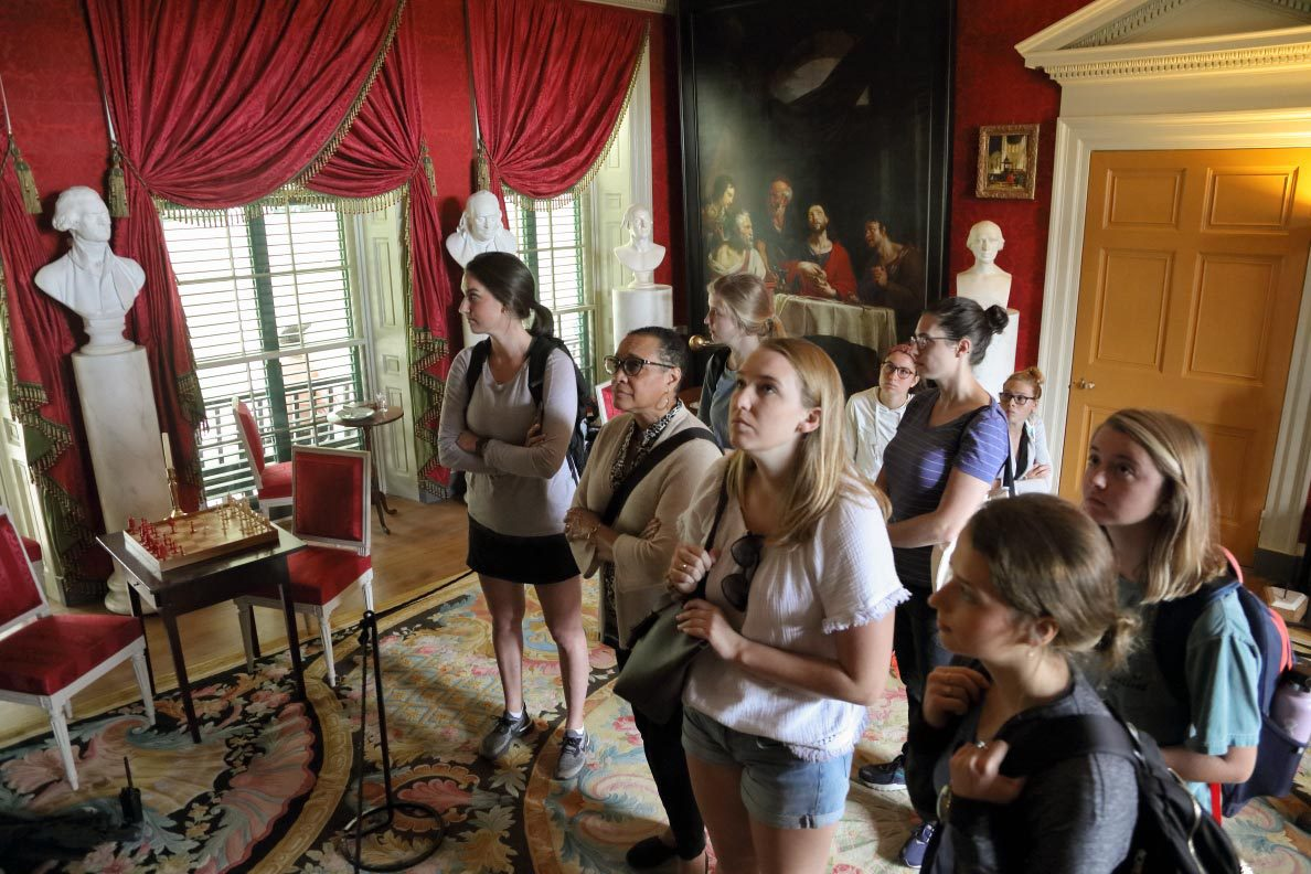 Patrice Preston Grimes, second from left, an associate professor in the Curry School of Education and Human Development, accompanies a group of her master's students on a field experience to James Madison's Montpelier.