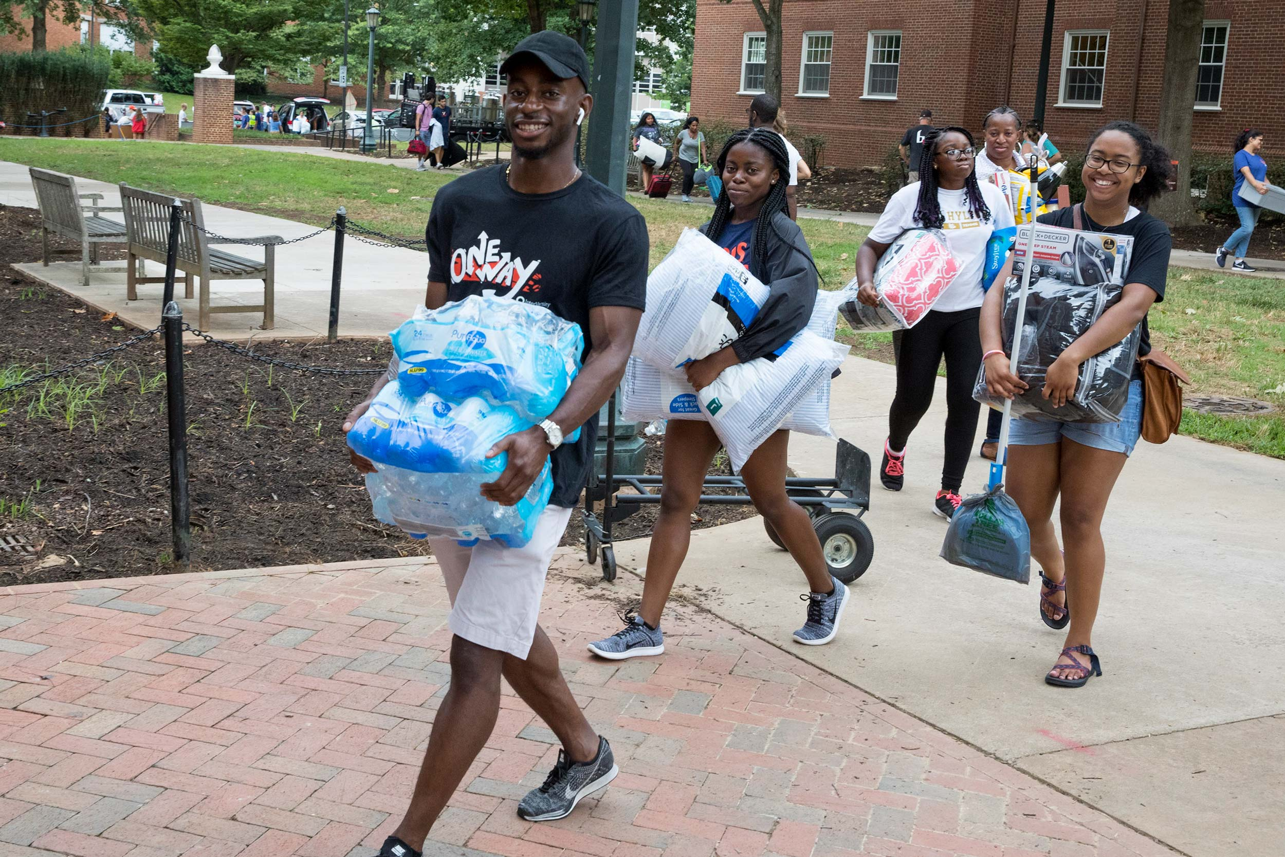 UVA's Grounds were abuzz Friday, the first day of move-in weekend. (Photos by Dan Addison, University Communications)