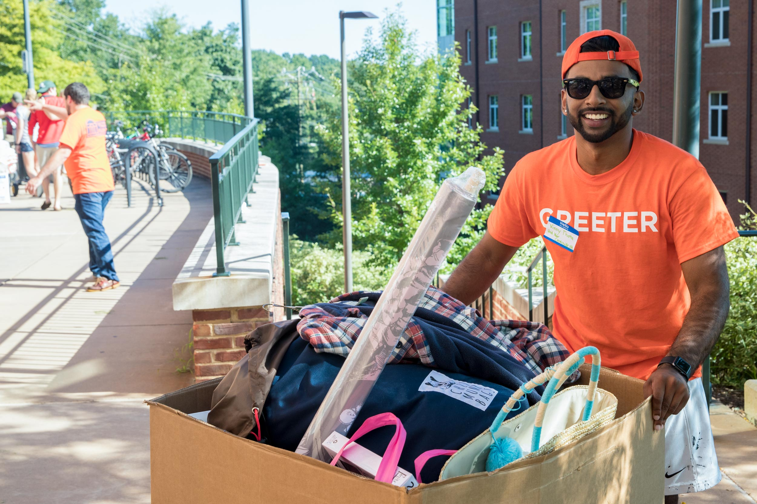 Third-year student Vinny Thota said he volunteered to be a Greeter at Kellogg last summer because a Greeter helped him move there his first year.