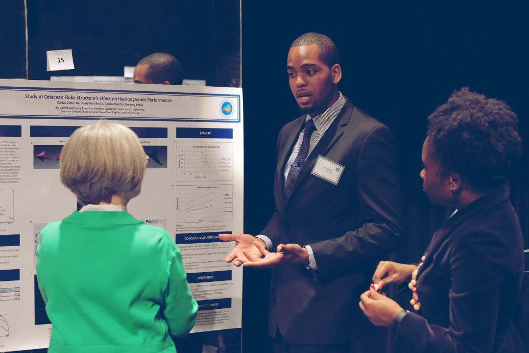 Darius Carter, a third-year mechanical engineering major at UVA, presented his research on the fluid mechanics of dolphin and whale fluke movement at VA-NC Alliance symposium last week. (Photo by Tom Cogill)
