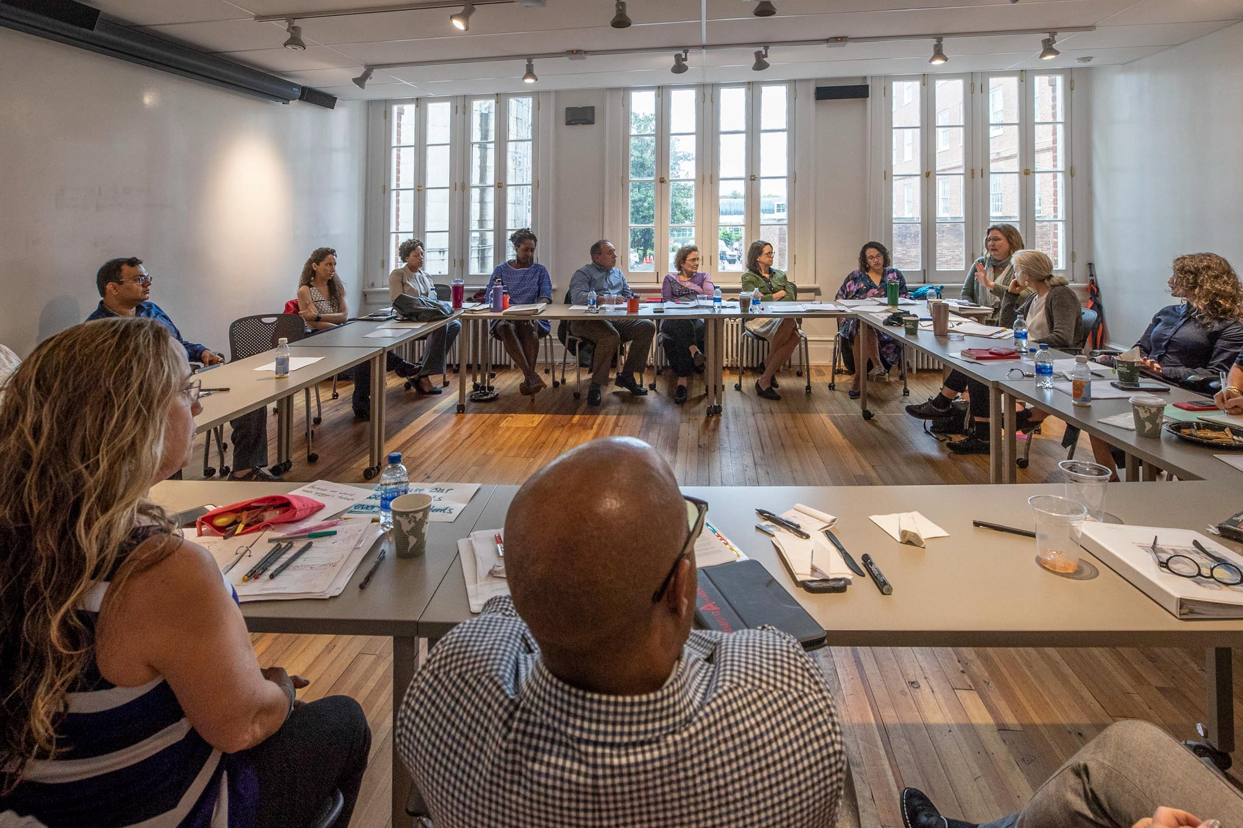 Twenty UVA professors participated in the Public Voices Fellowship program, meeting periodically to work on how to be effective writers who might influence public opinion.