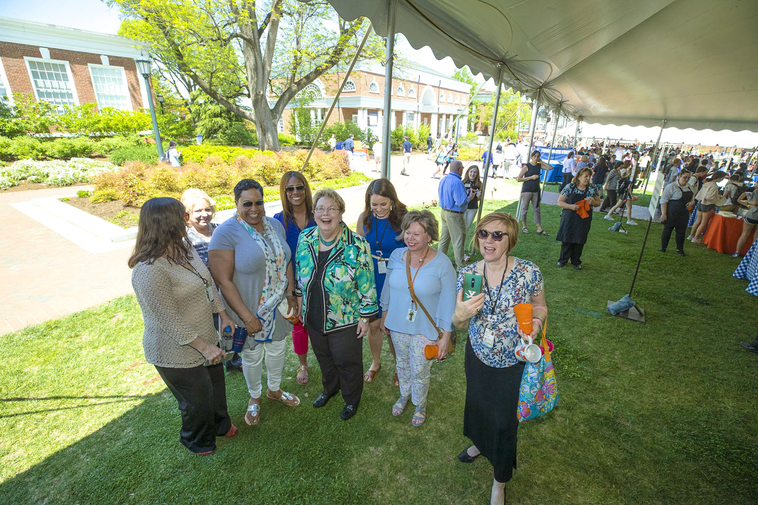 University President Teresa A. Sullivan surrounded by well-wishers at the picnic in her honor.