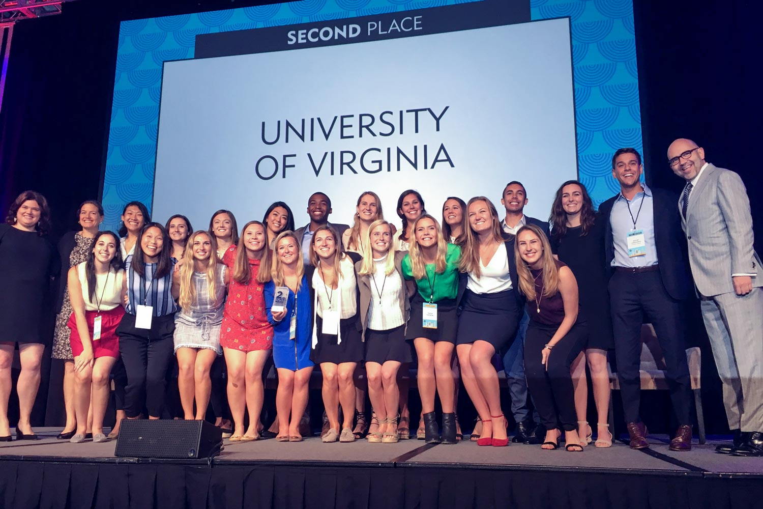 """Students in professor Carrie Heilman's """"Promotions"""" class celebrate on stage in Chicago at the National Student Advertising Competition last week."""
