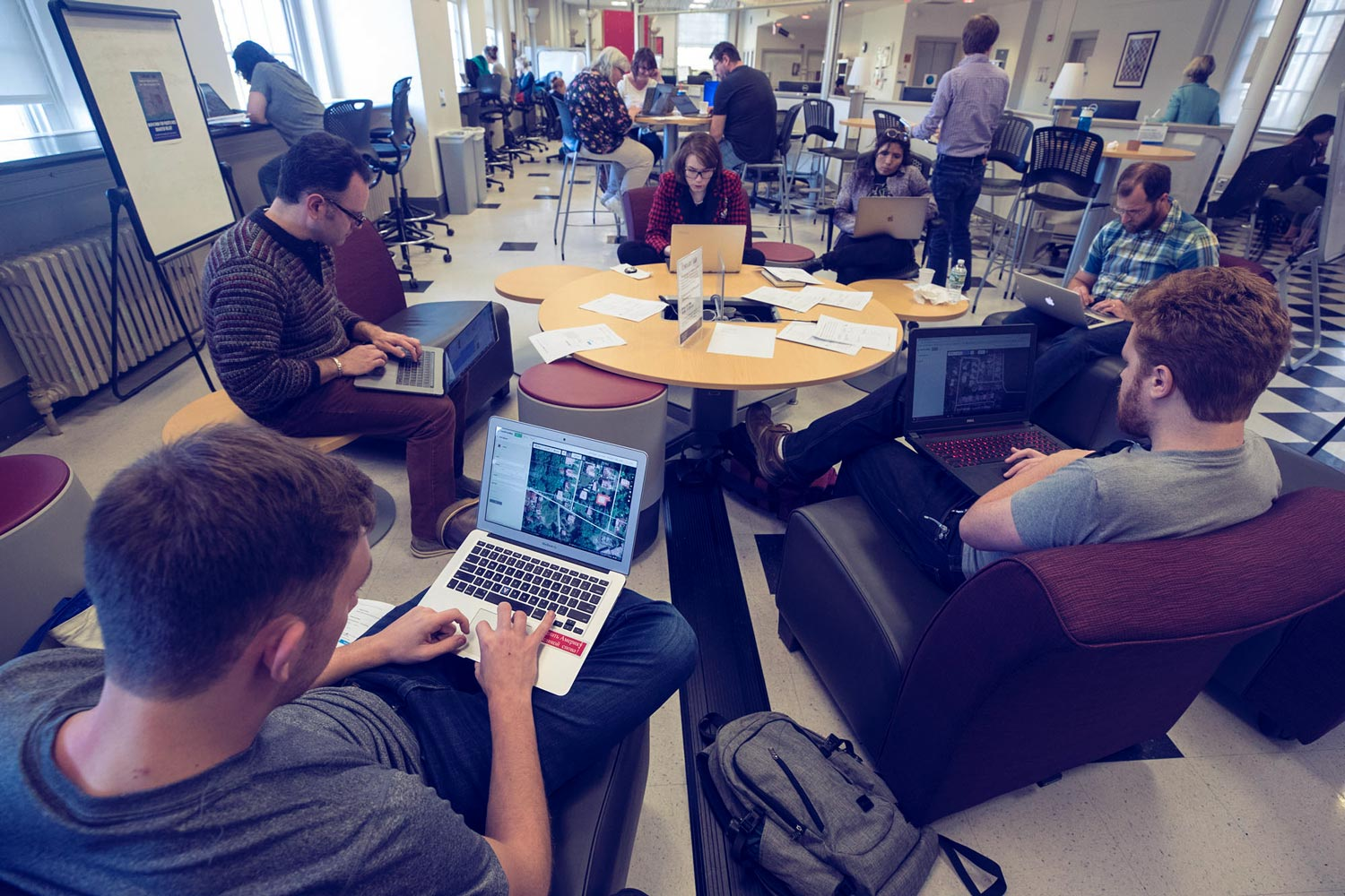 Students and faculty members worked in small groups on Thursday, updating maps to reflect the current state of buildings and bridges in Puerto Rico.