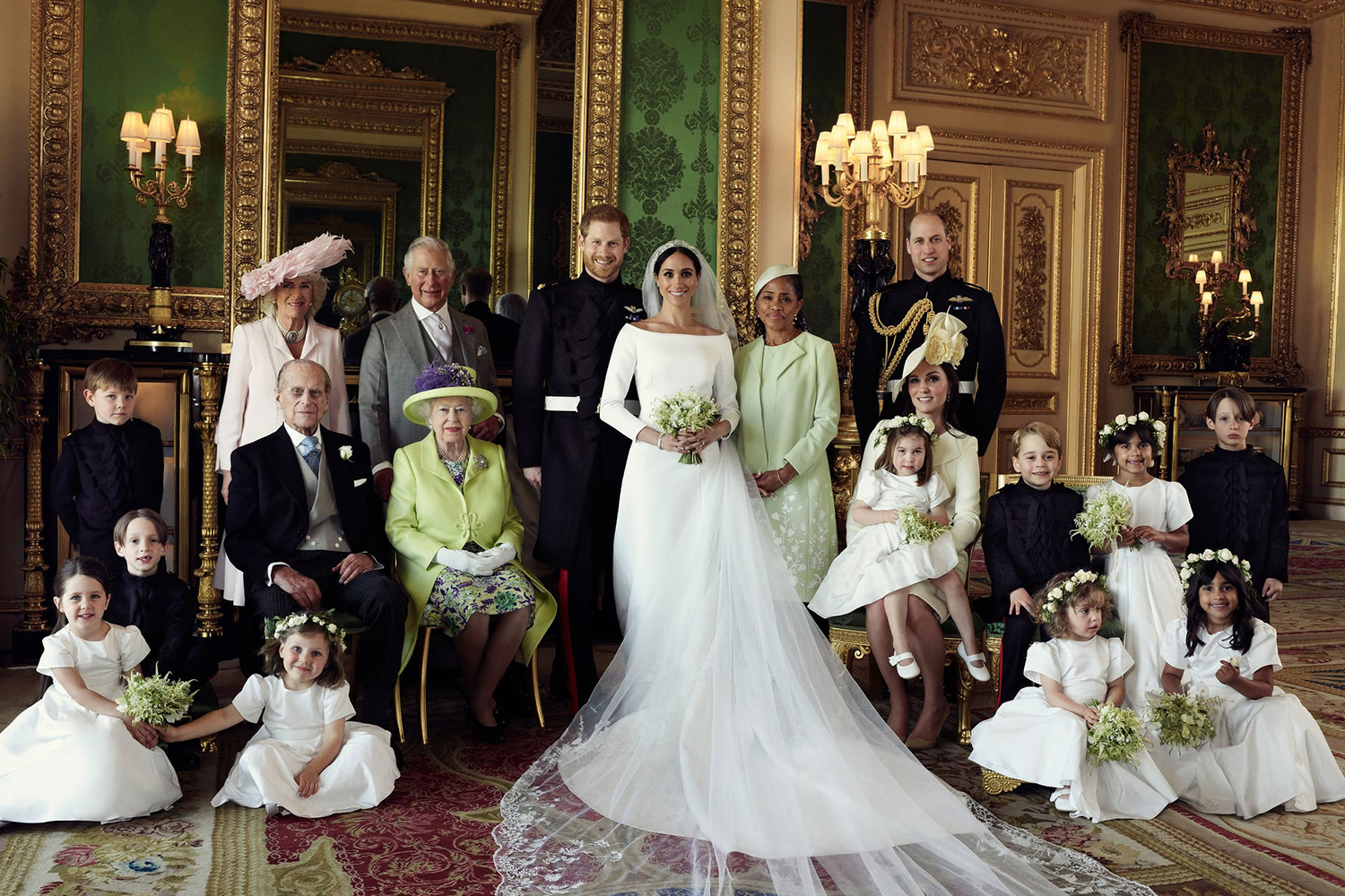 Prince Harry and Meghan Markle – the newly minted Duke and Duchess of Sussex – with their family, bridesmaids and pageboys after the wedding.