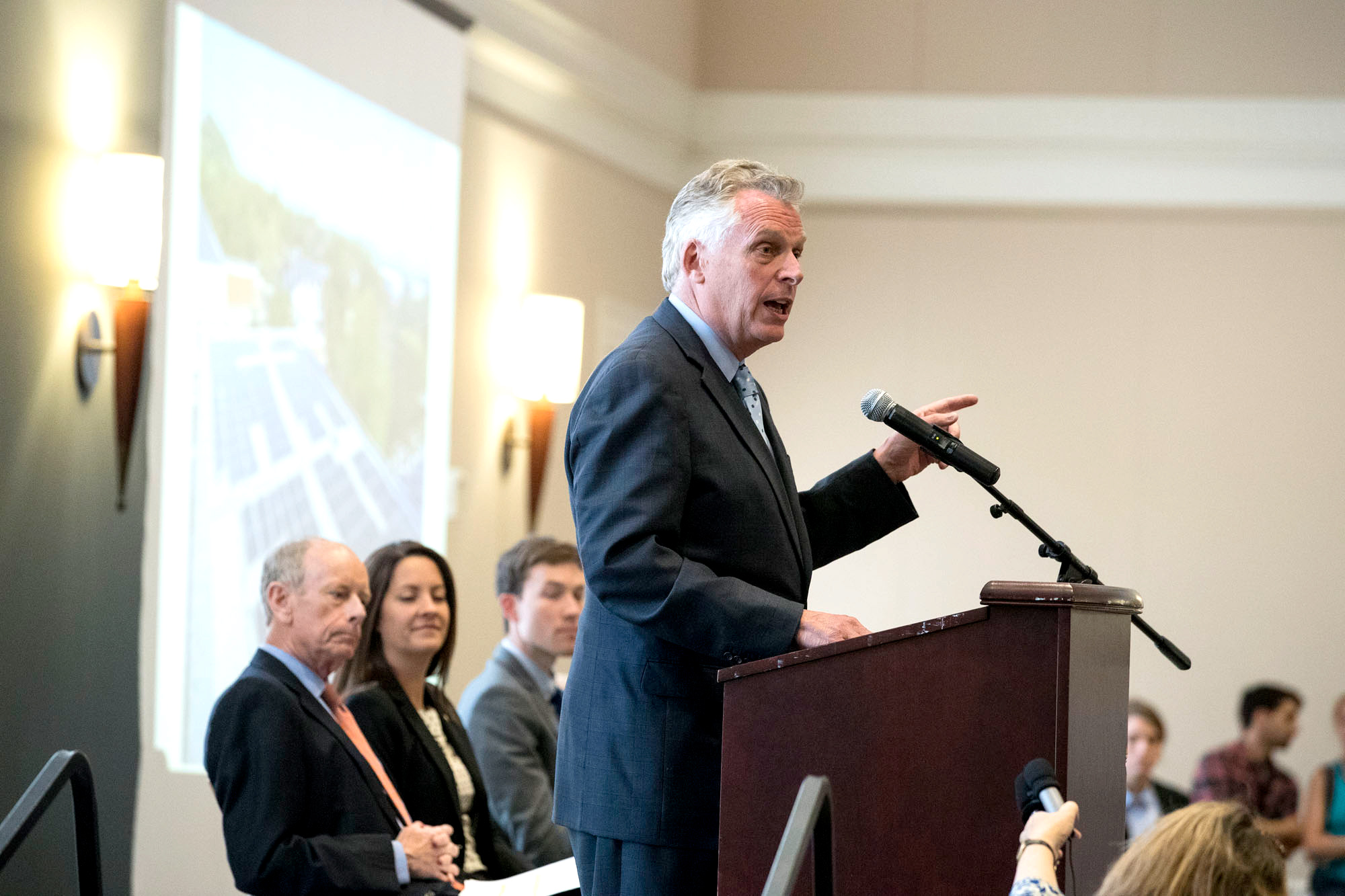 McAuliffe cut a symbolic ribbon for the array, which has been in place since February and is on its way toward producing nearly 200,000 kilowatt hours of electricity this year.