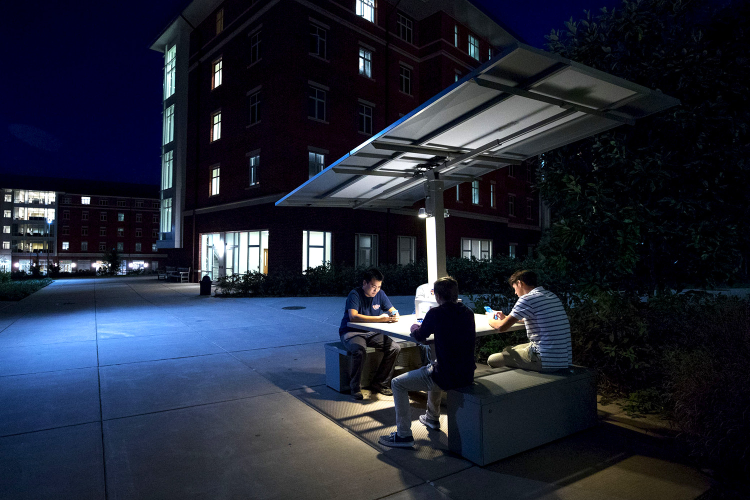 A student initiative resulted in the installation of a solar table outside Lile-Maupin House, where students can recharge batteries while collaborating on projects. (Photo by Sanjay Suchak, University Communications)