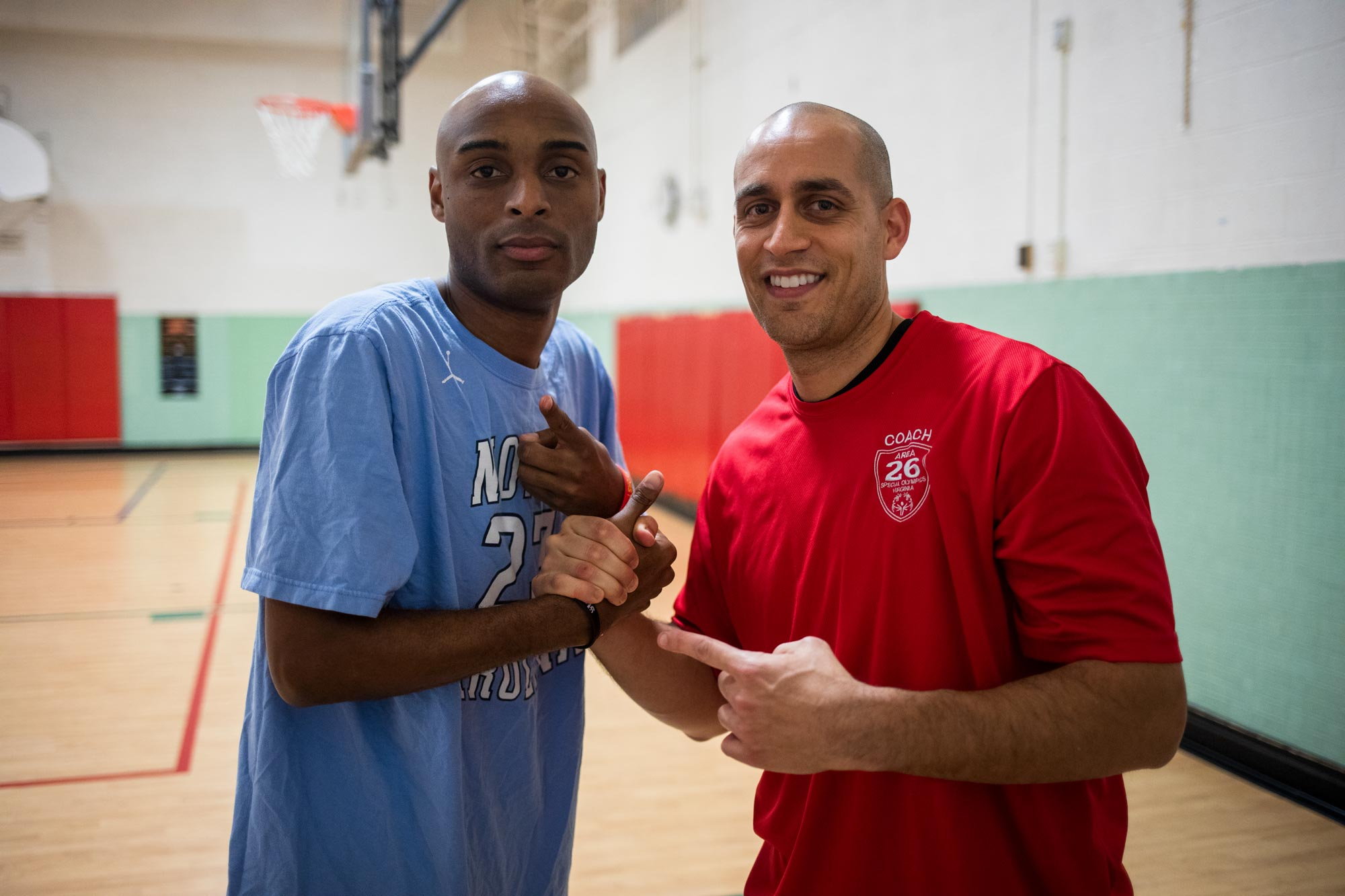 Emilio Alonso, right, has coached Special Olympian Chris Carter for eight years.