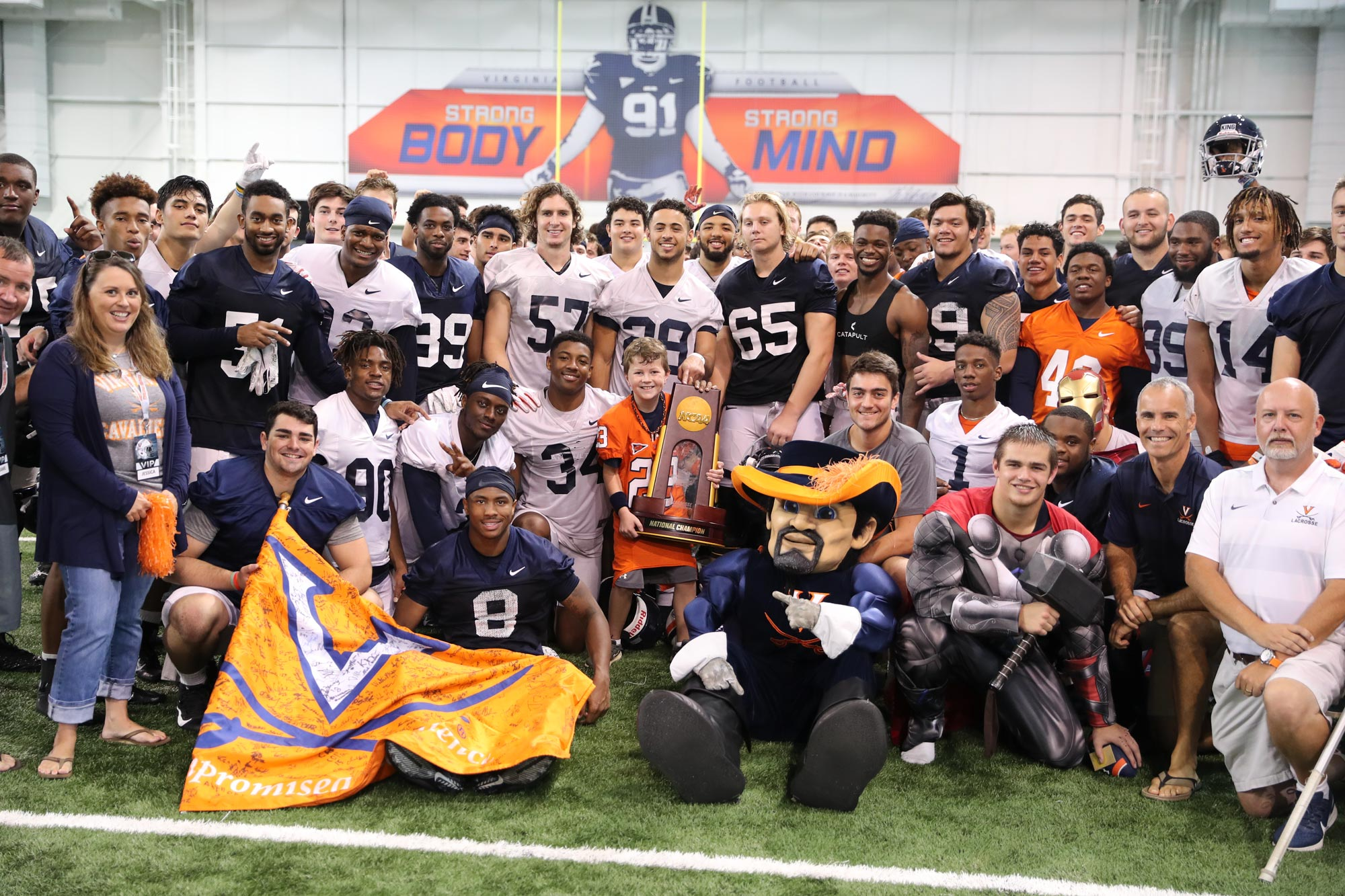 The UVA football program participates in a recent Thursday's Heroes event.