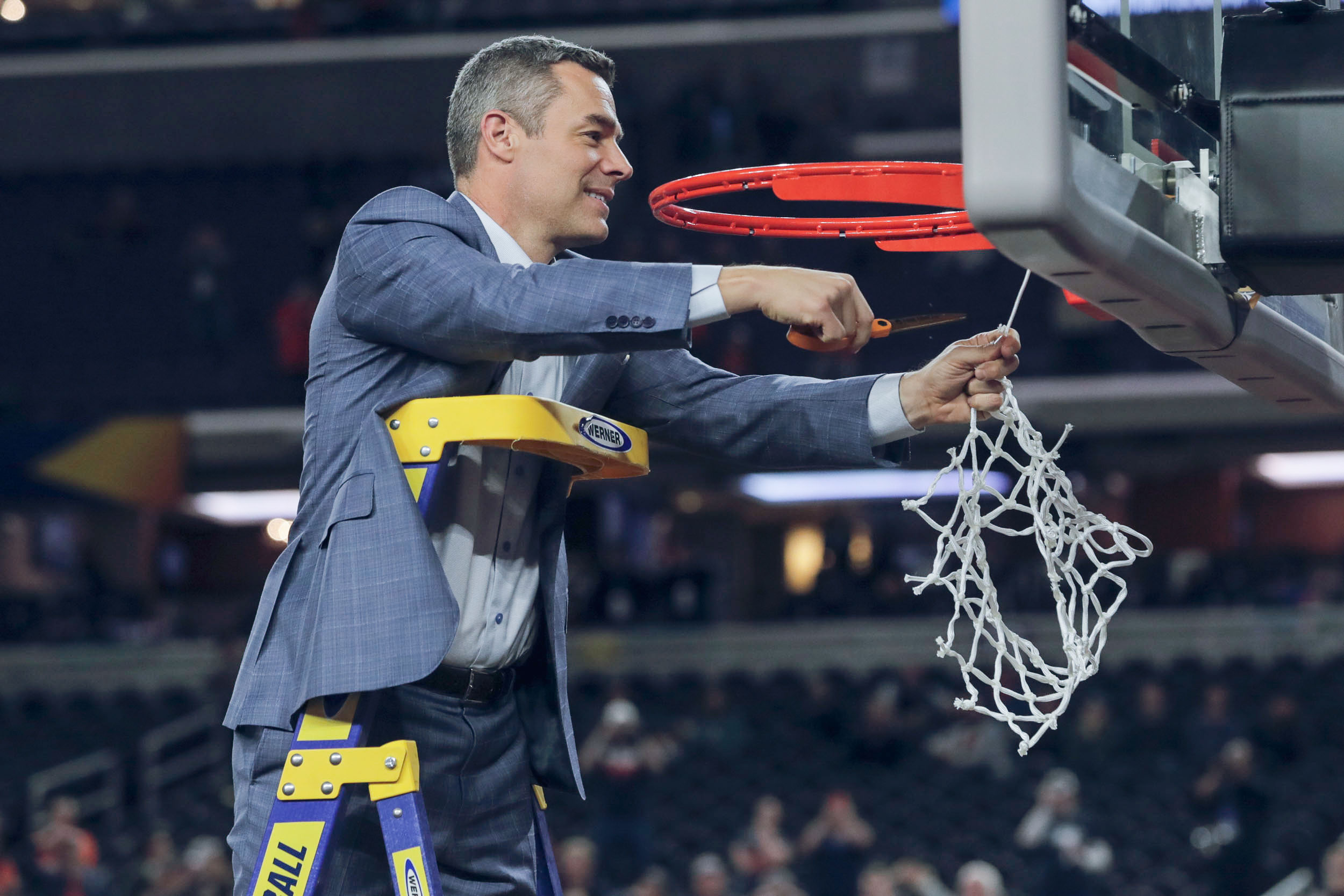 UVA men's basketball coach Tony Bennett cuts down the net after the Cavaliers won the NCAA championship on April 8.