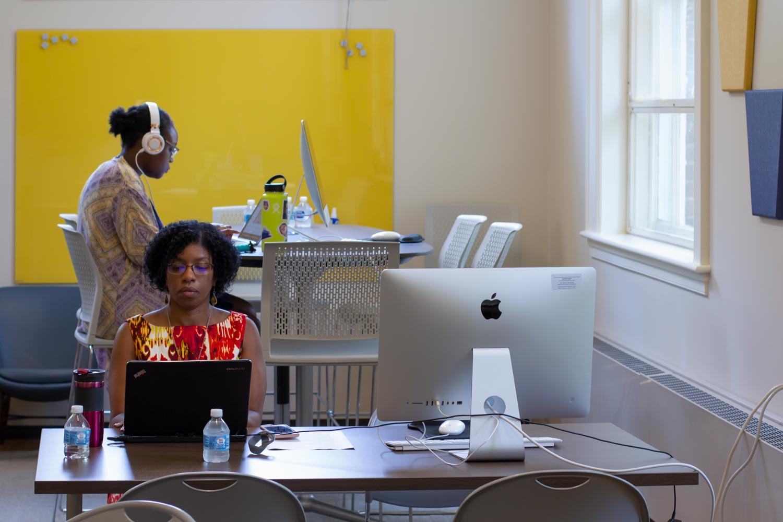 Woman at desk transcribing
