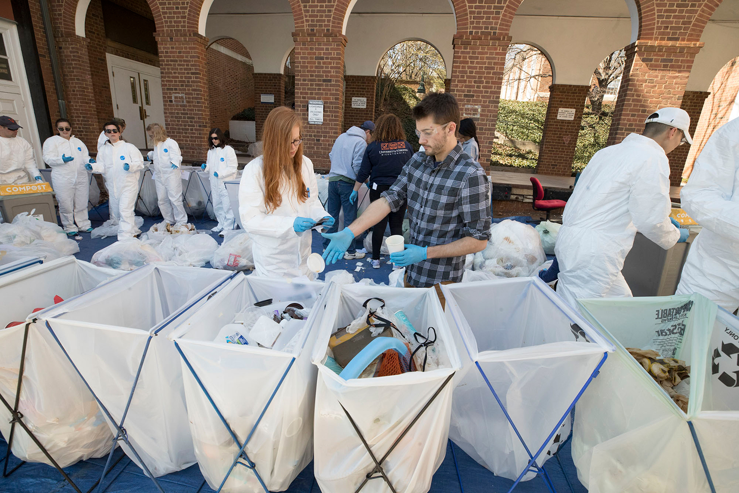 Engineering students go through trash behind Thornton and Olsson halls as part of a waste stream inventory. (Photos by Dan Addison, University Communications)