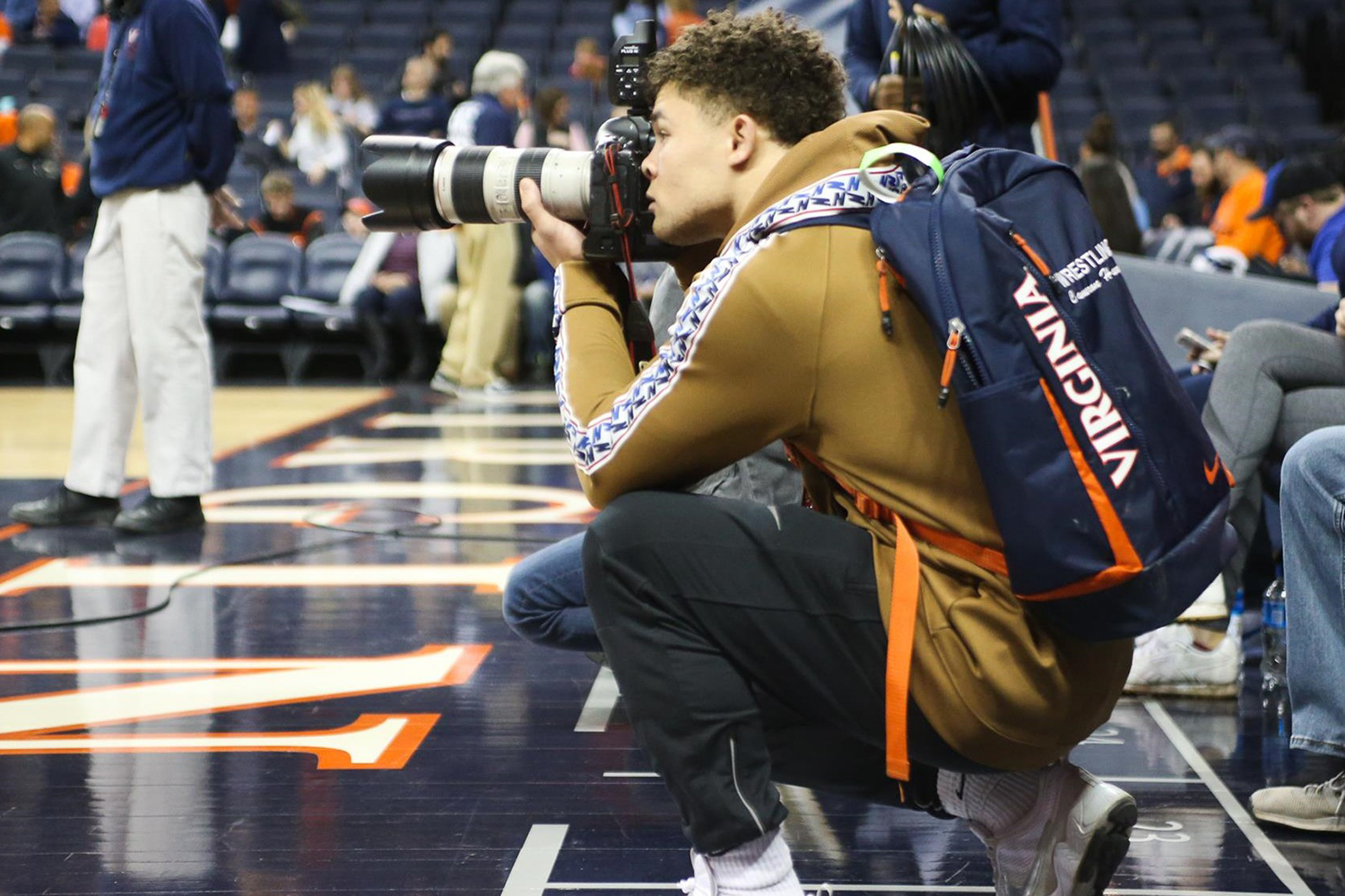 After multiple concussions forced Cam Harrell to give up his wrestling career, he is indulging in a new passion – photography – as an intern in the UVA athletics department.