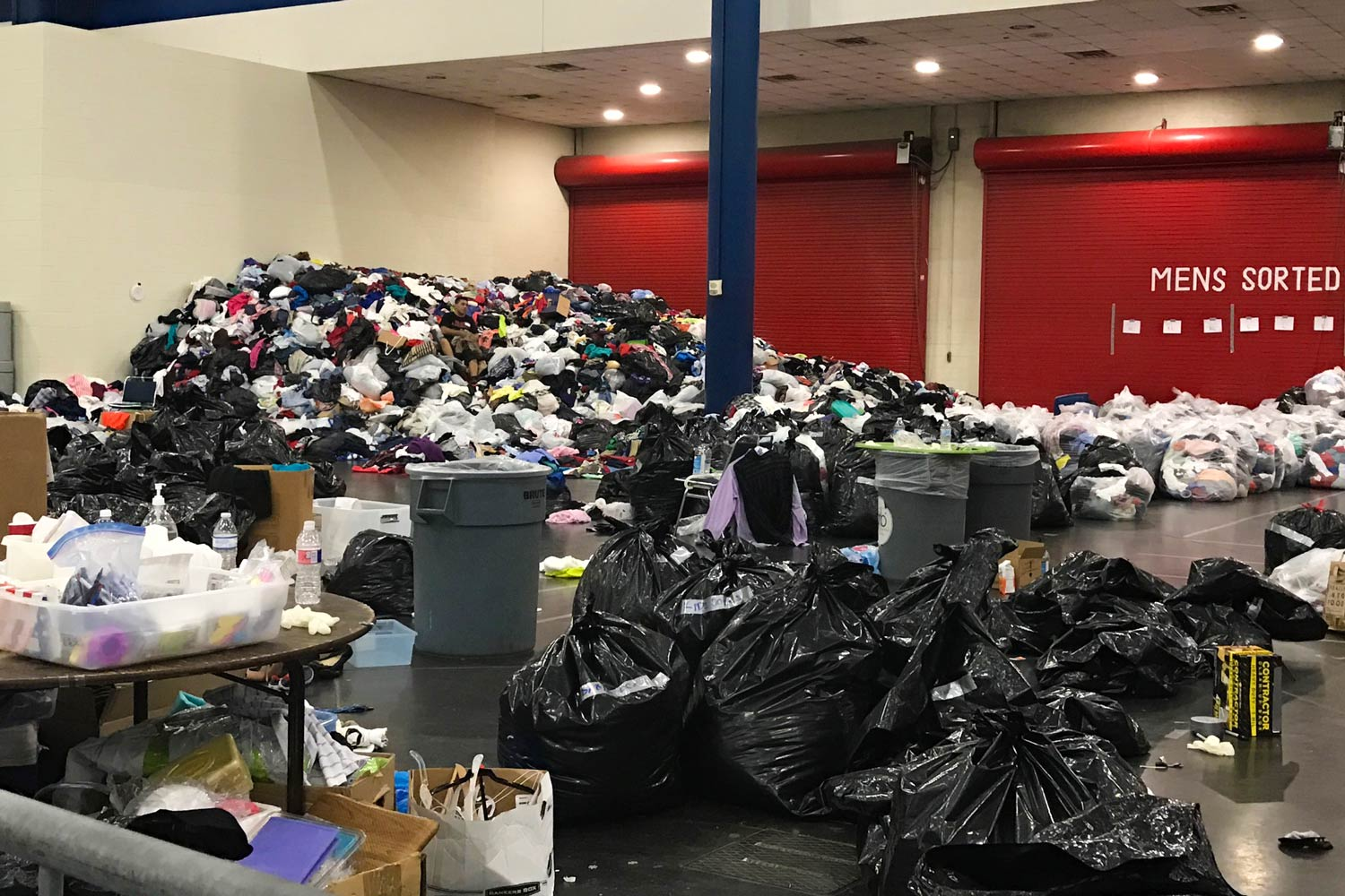 Surveying mounds of donations at a Houston shelter.