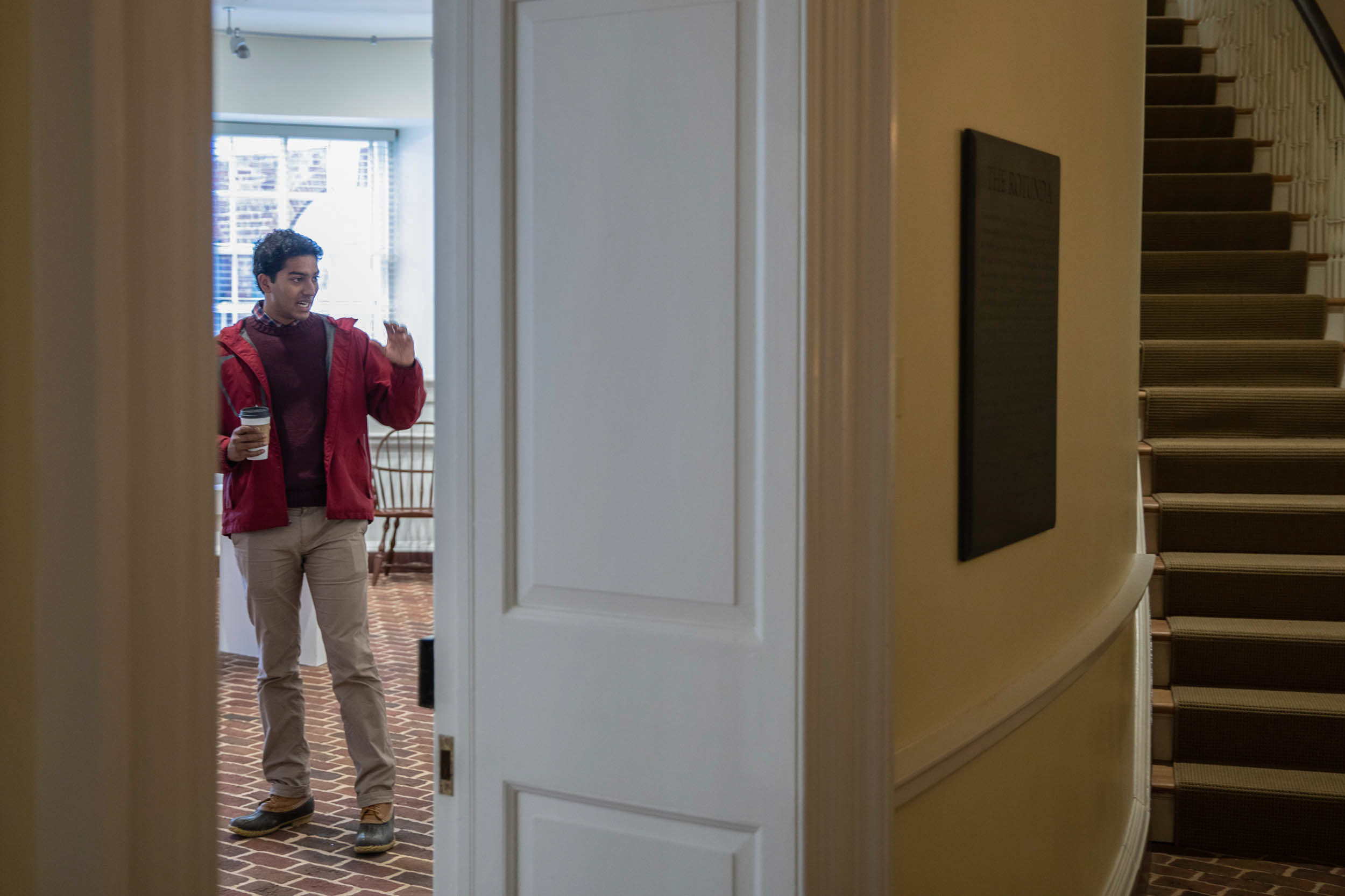 Samuel begins a tour in the Rotunda's Lower East Oval Room, home to a museum exhibit that highlights the Thomas Jefferson-era chemical hearth, which was part of an early science classroom.
