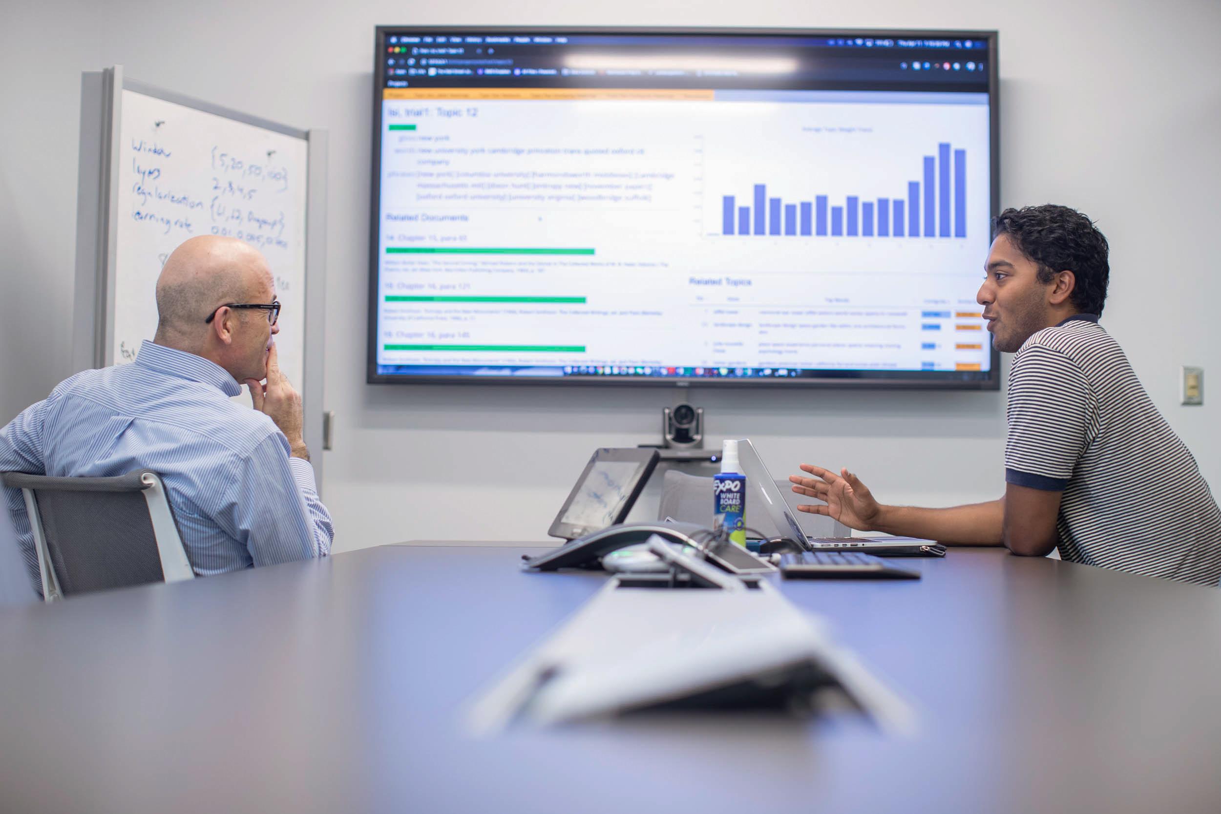 Samuel discusses his capstone project this spring with Rafael Alvarado, the program director of the Data Science Institute.