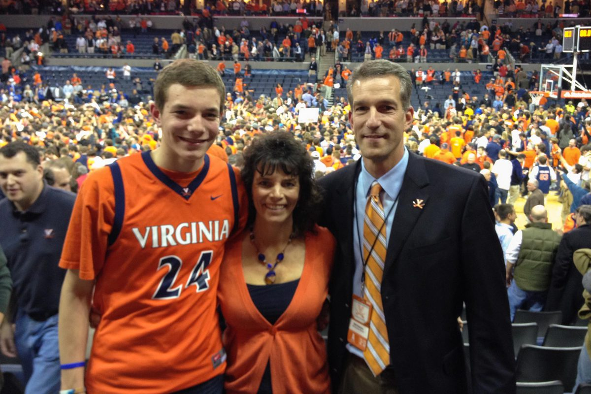 Austin Katstra at a game with his father, Dirk, and his mother, Michelle, before he became a student at UVA.