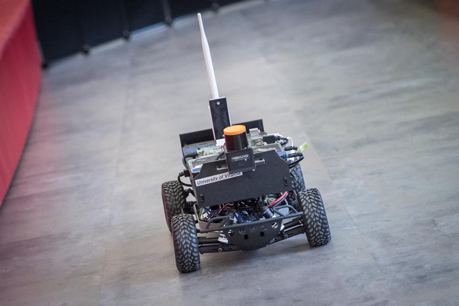 An autonomous car model is tested on a track in the Engineering School's Link Lab.