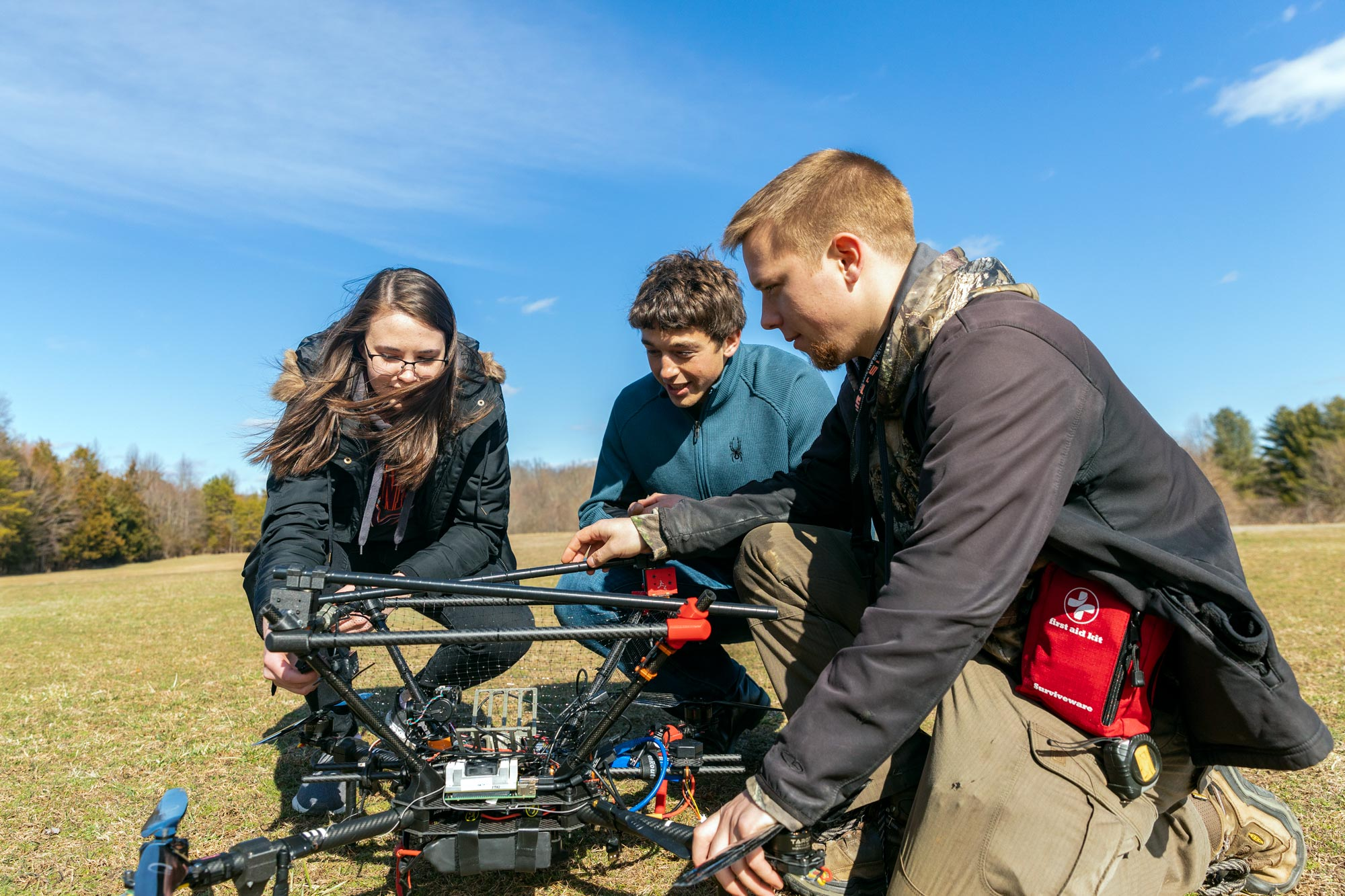 Students from the autonomous robotics team test an aerial drone on UVA's Milton Field in preparation for an international robotic competition.