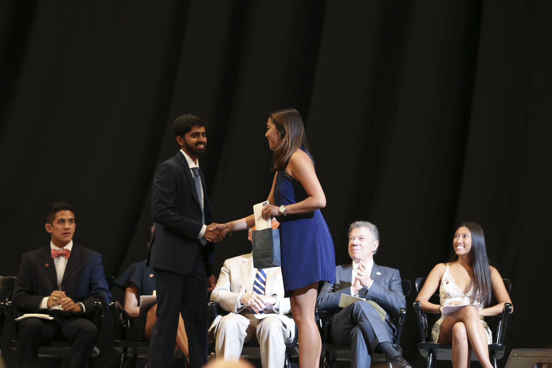 Class of 2017 trustee Ngan K. Pham, presented the community service award to commerce graduate Shreyas R. Hariharan.