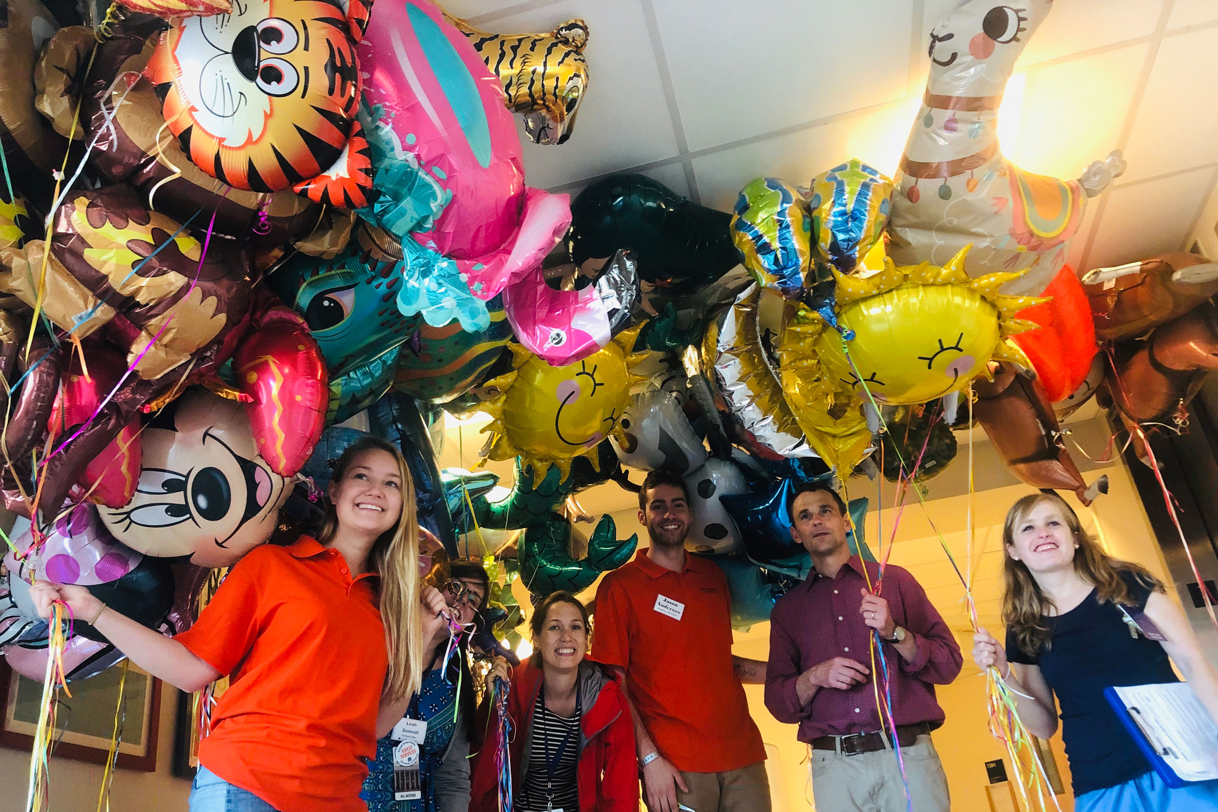 UVA President Jim Ryan, second from right, and members of his staff helped deliver the balloons to the hospital on Saturday. (Contributed photo)