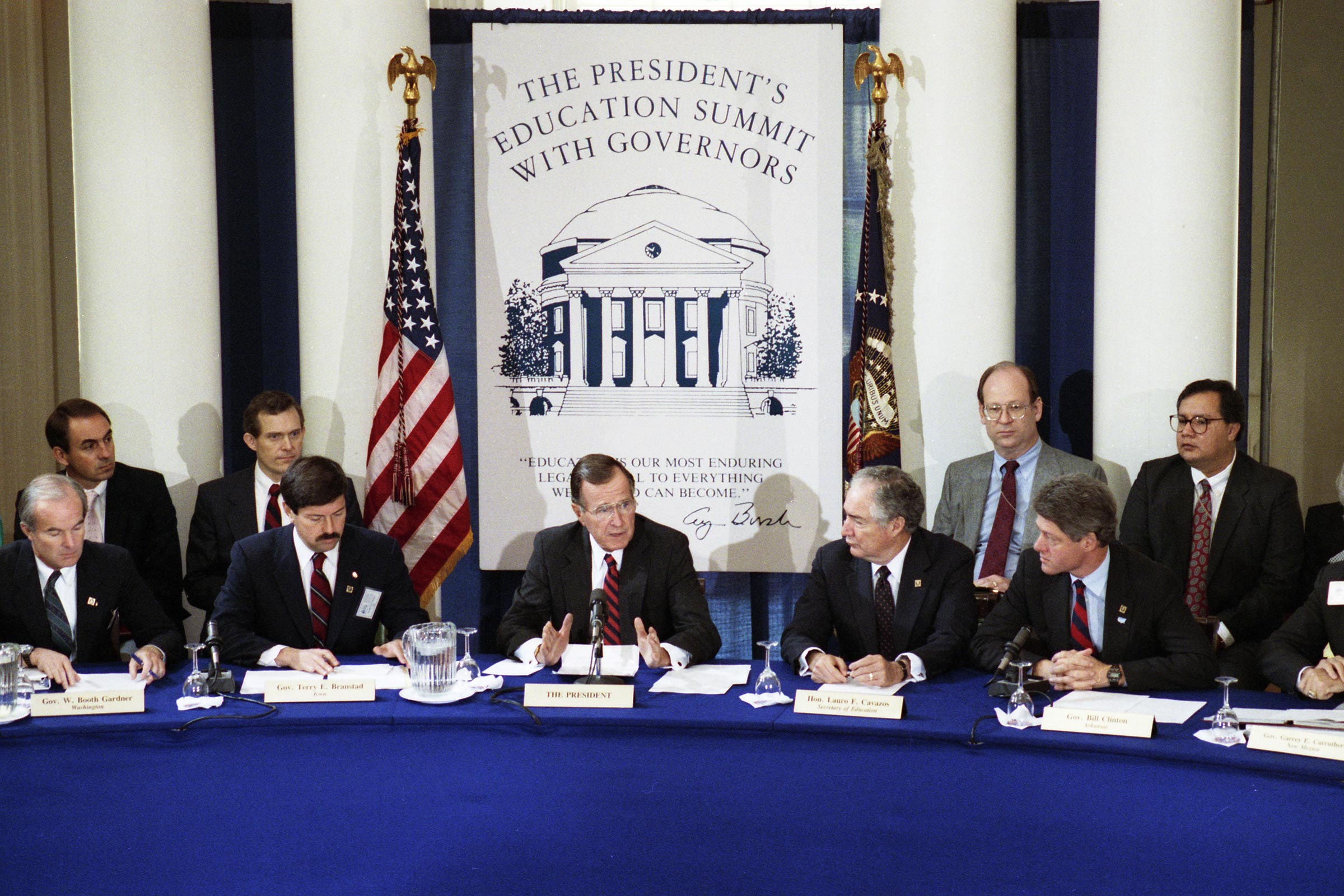 Clinton, right, at the time governor of Arkansas, and former President George H.W. Bush, center, at a governors' education summit at UVA during Bush's presidency.