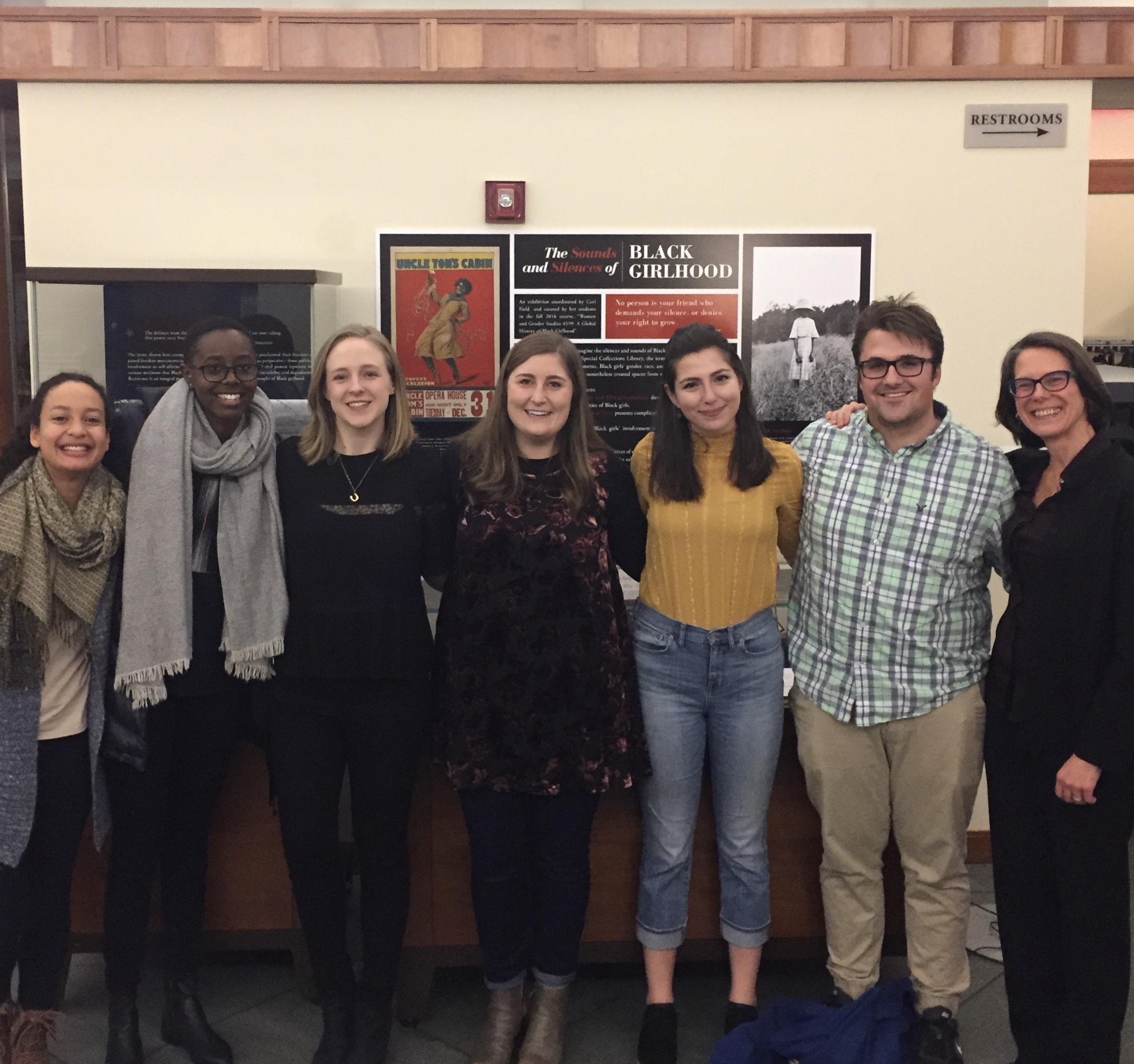 Assistant professor Corinne Field, right, with some of the students in her Global Black Girlhood class who created an exhibit at the Small Special Collections Library.