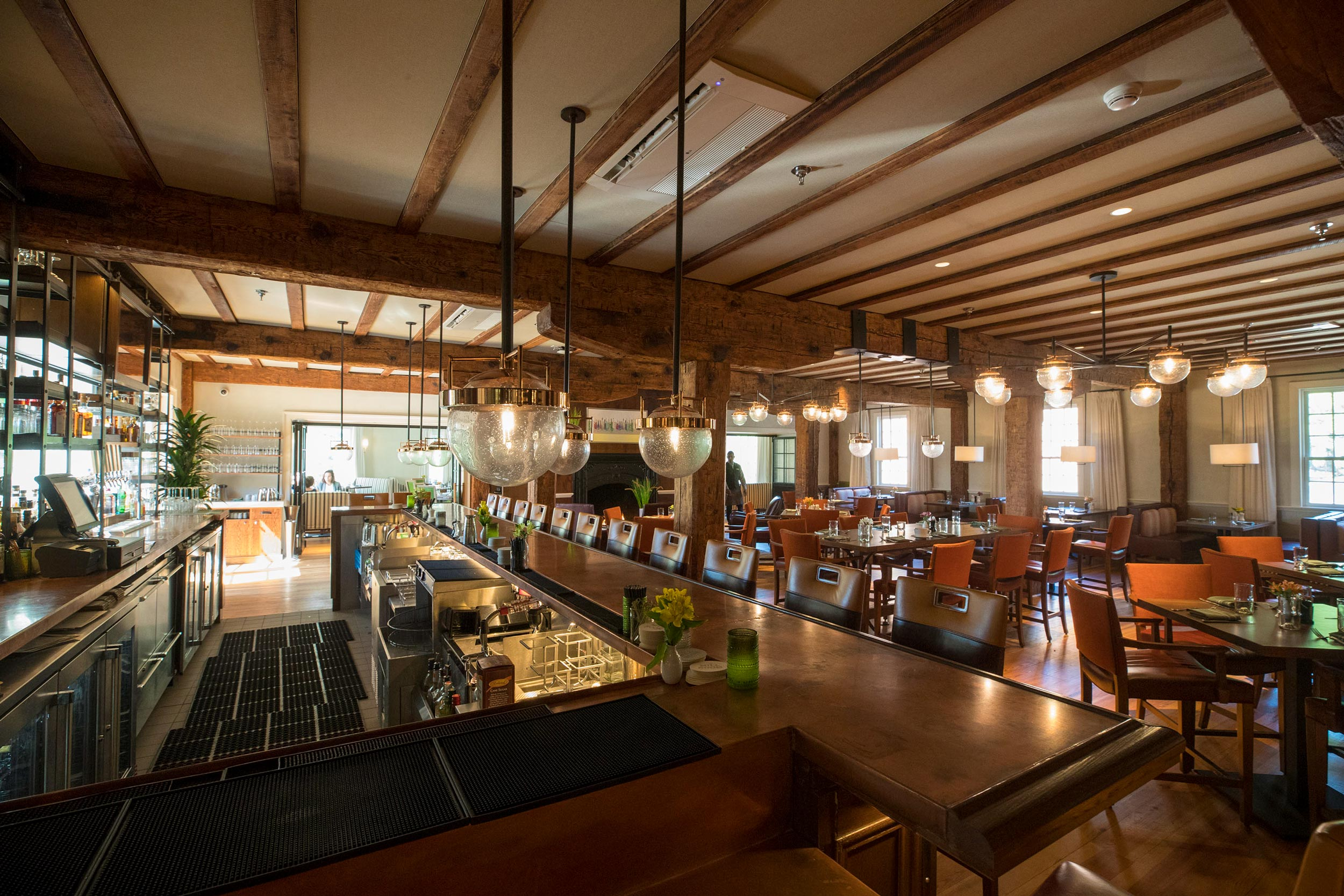 Wood beams from 1834 create a focal point in the renovated Mill Room.