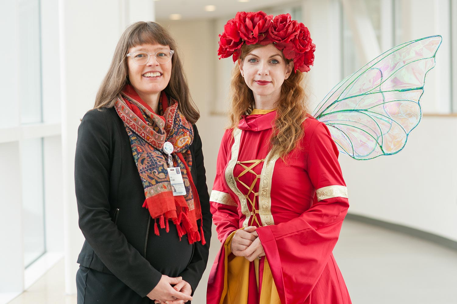 Lydia Witman, left, manages Patient & Family Library Services, an extension of the Claude Moore Health Sciences Library, and connected Briar the Book Faery with the hospital's Storytime Program.