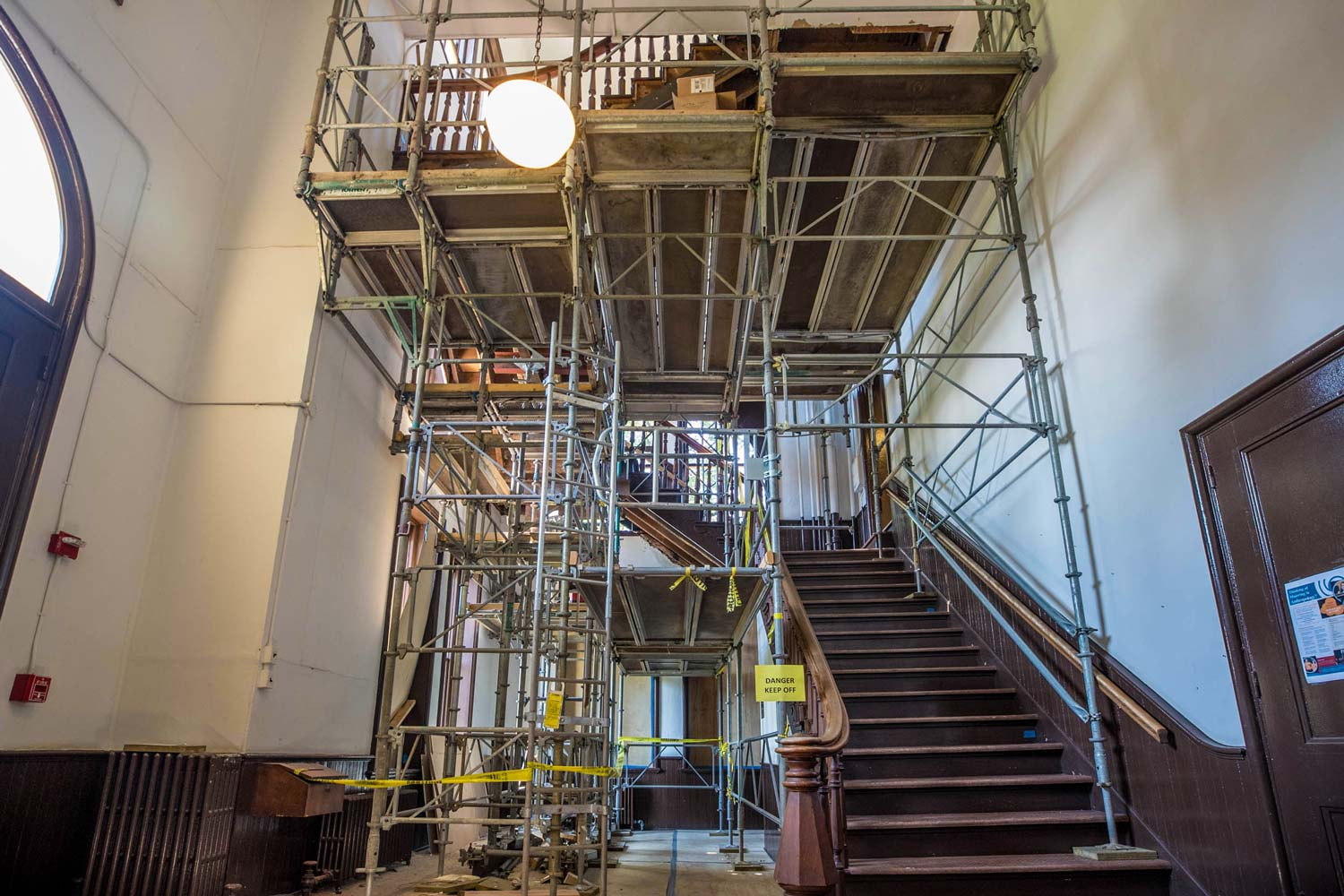 The grand staircase in Brooks Hall. Workers renovating it found evidence of a long-forgotten 1915 fire.