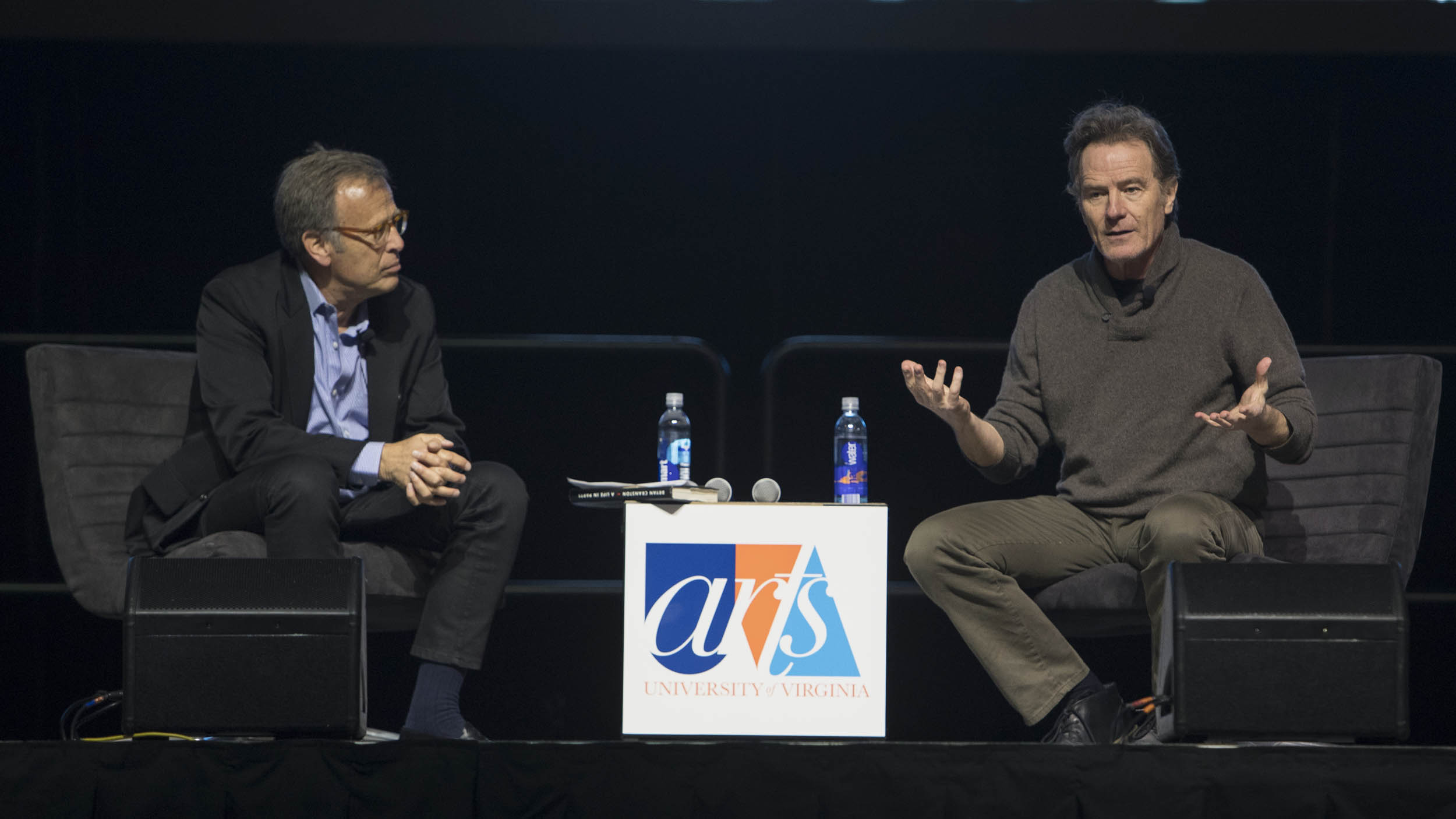 "UVA alumnus Mark Johnson, a decorated producer who worked on ""Breaking Bad,"" joined Cranston on stage. (Photo by Sanjay Suchak, University Communications)"