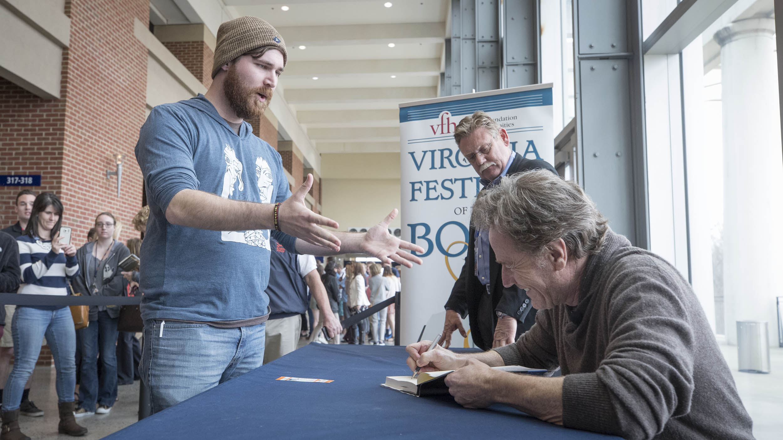 """After his talk, Cranston signed copies of his new memoir, """"A Life in Parts."""" (Photo by Sanjay Suchak, University Communications)"""