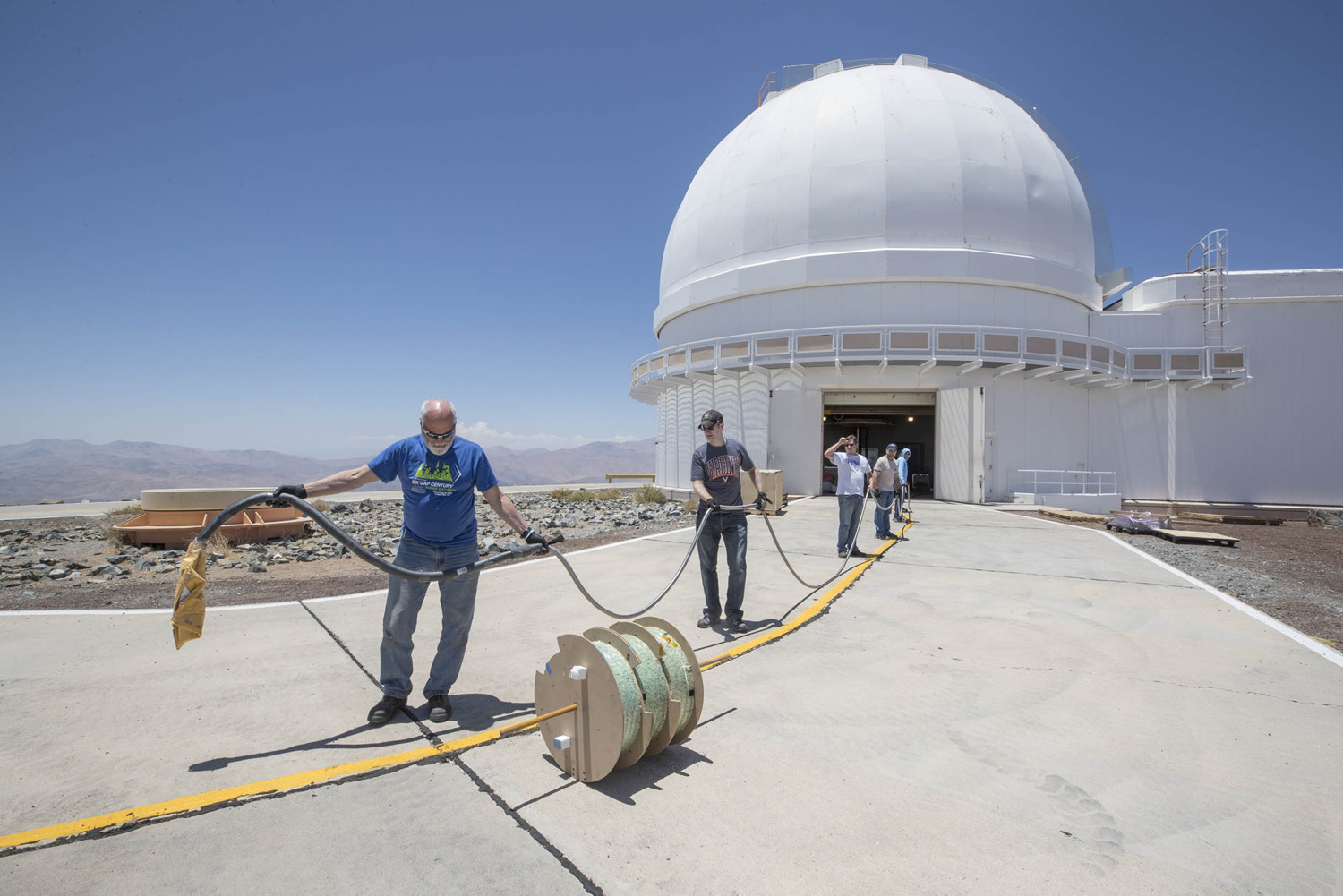 The UVA team spooled out the delicate fiber-optic cable that runs from the instrument to the telescope.