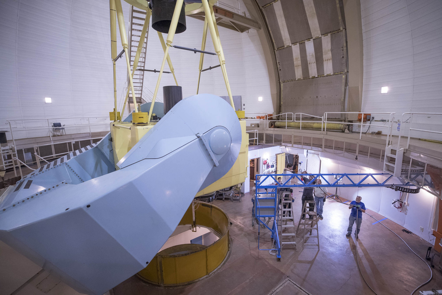 The team from UVA worked in the dome room of the telescope on the arm and connection for the spectrograph as part of the APOGEE project.