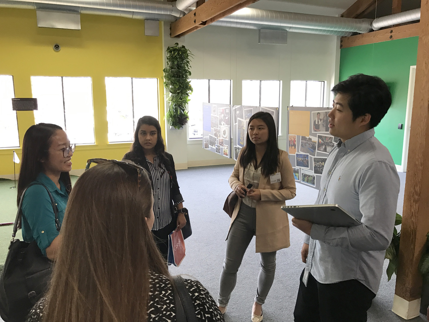 2012 graduate Jichao Li, right, now a software engineer at Google, showed students around the company's global headquarters in Mountain View, California. (Photo courtesy of Ryan Wright)