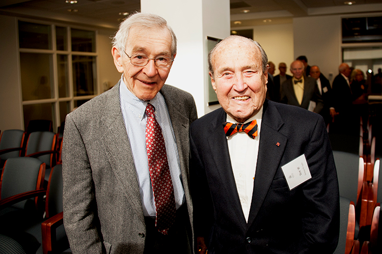 Mortimer Caplin, right, with his law firm co-founder, Doug Drysdale, in 2014.
