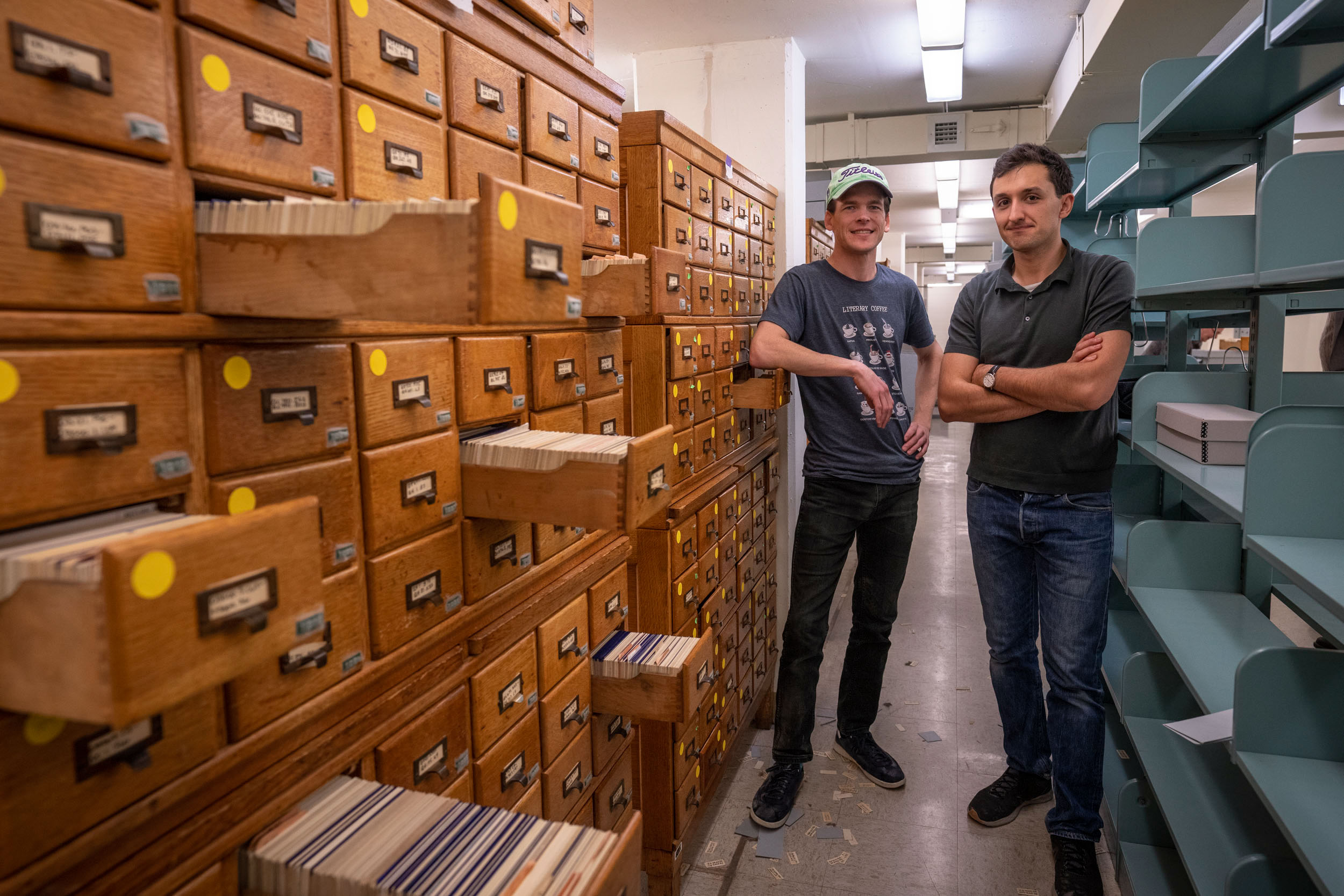 English graduate students Neal Curtis and Samuel Lemley in the Alderman card collection.
