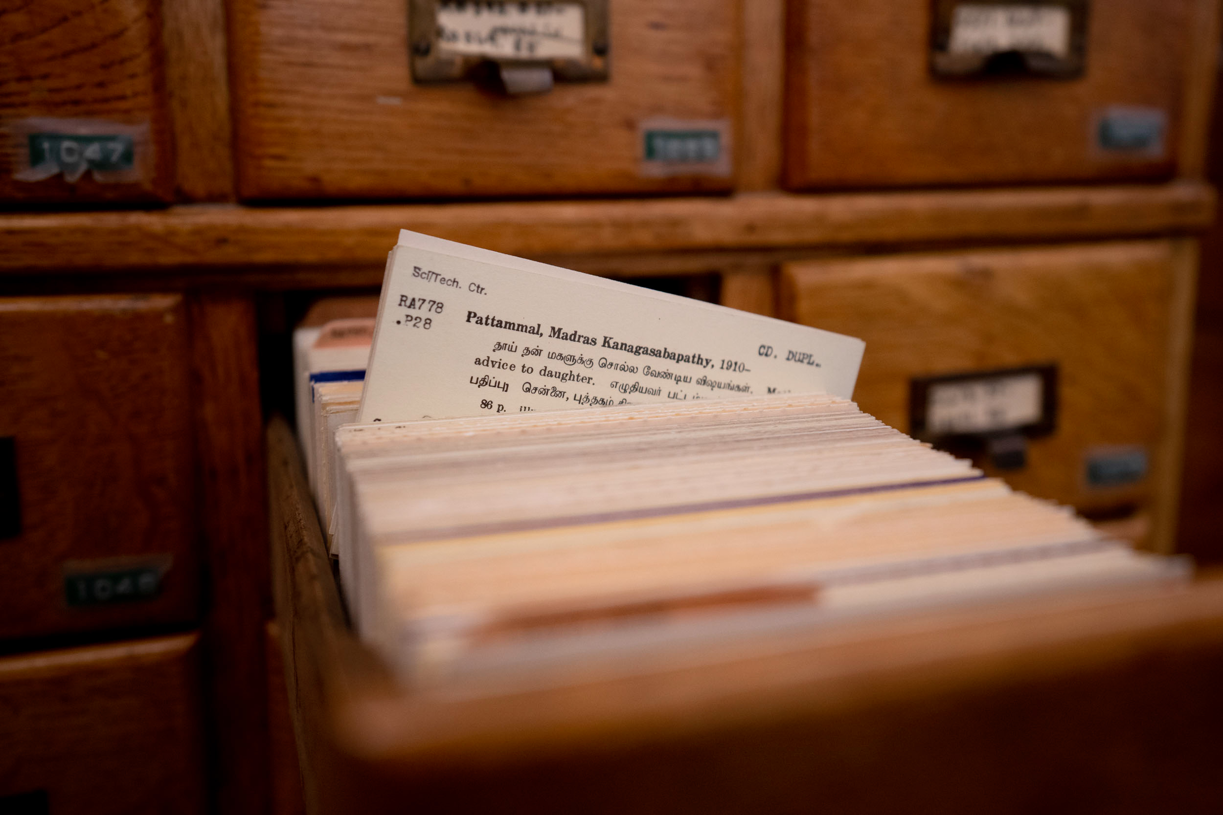 Index card in a wooden drawer.