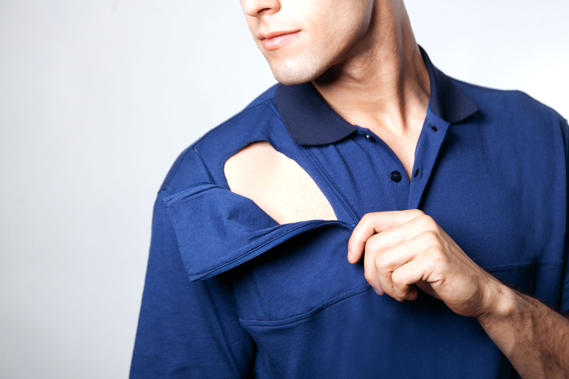"""A shirt designed to accommodate and provide easy access to chest ports looks like """"a really nice polo,"""" Razdan said."""