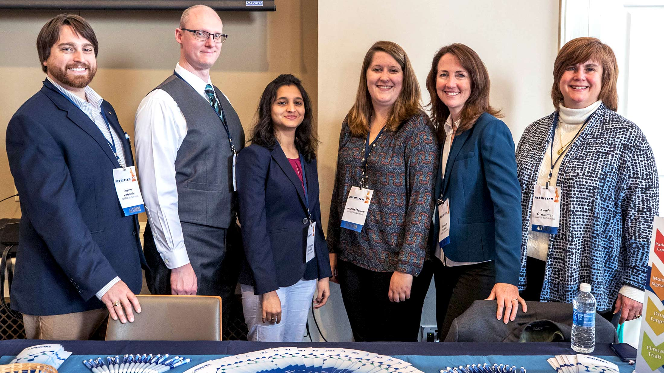 Grammer, far right, with her team from AMPEL BioSolutions, including from left to right, UVA alumnus Adam Labonte, Nick Geraci, Prathyusha Bachali, alumna Sarah Heuer and Rebecca Bender.