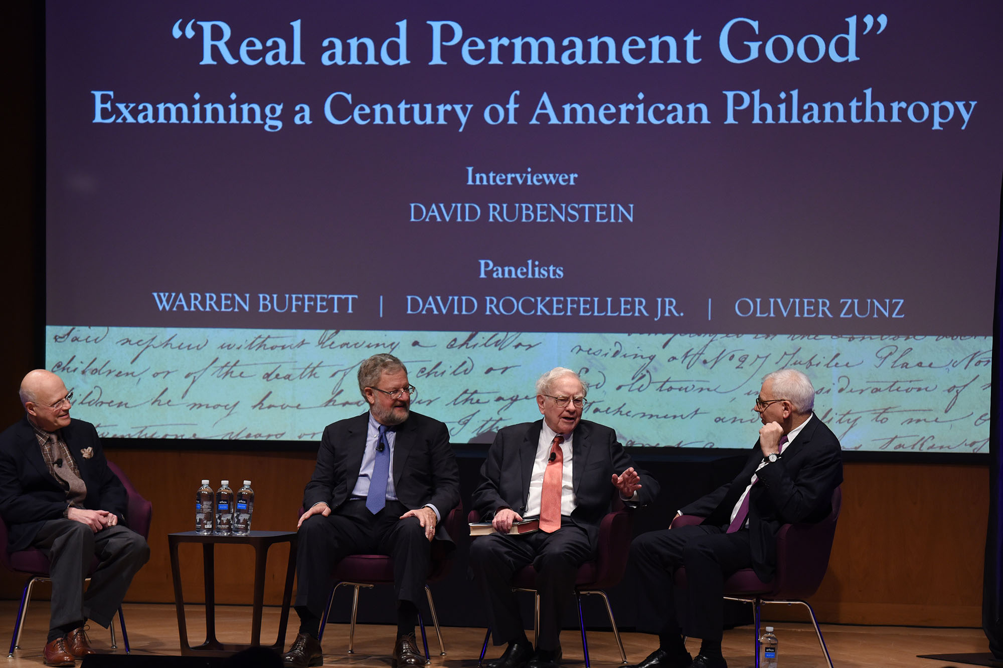Olivier Zunz (left), a Commonwealth Professor in the Corcoran Department of History at the University of Virginia, philanthropist David Rockefeller Jr. (second from left), Warren Buffet (center), chairman of the investment house Berkshire Hathaway, and ph