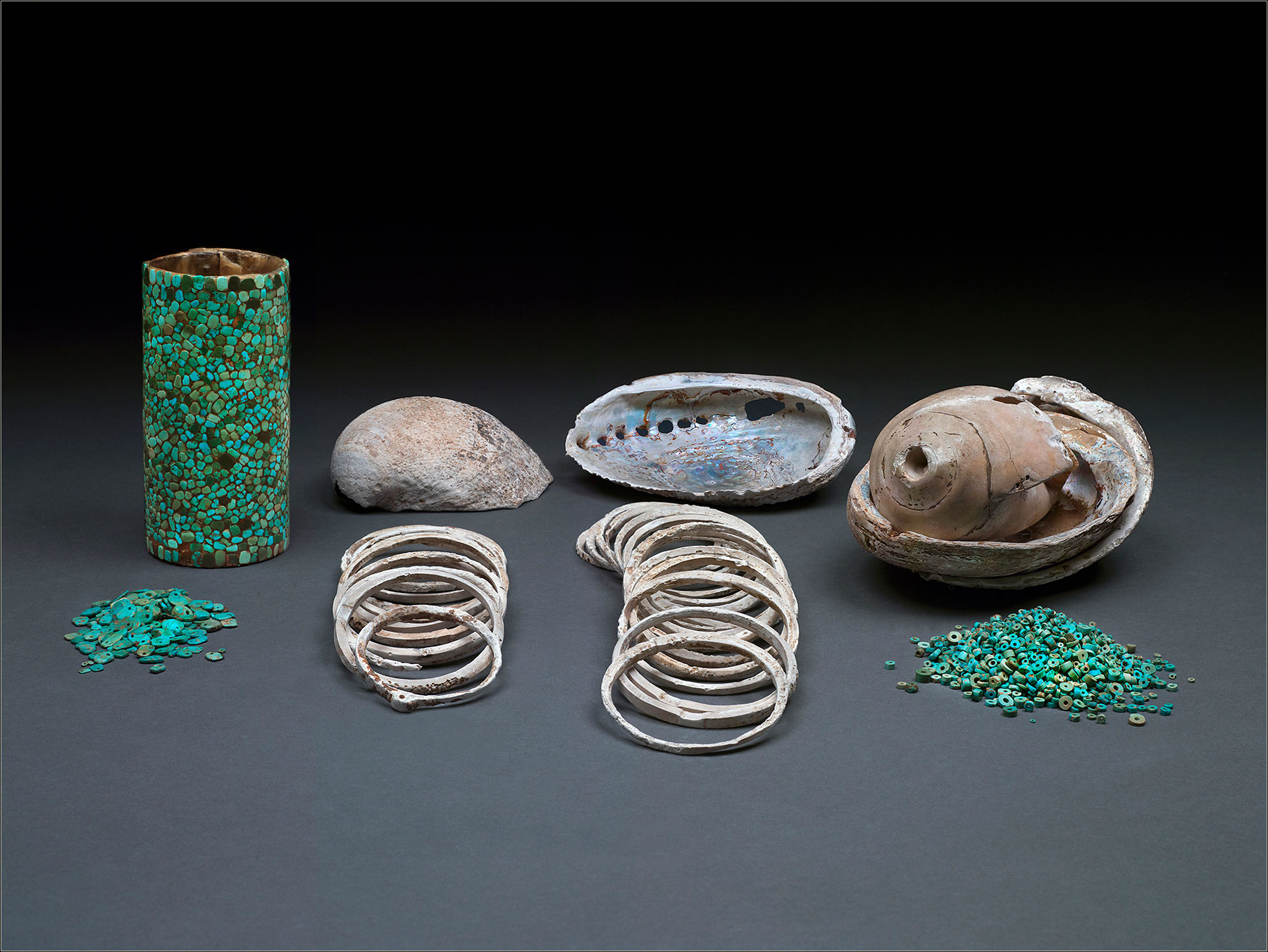 The richest burial in Pueblo Bonito included abalone shells, a conch shell trumpet, shell bracelets, turquoise jewelry and a wicker cylinder vessel covered with a turquoise mosaic.