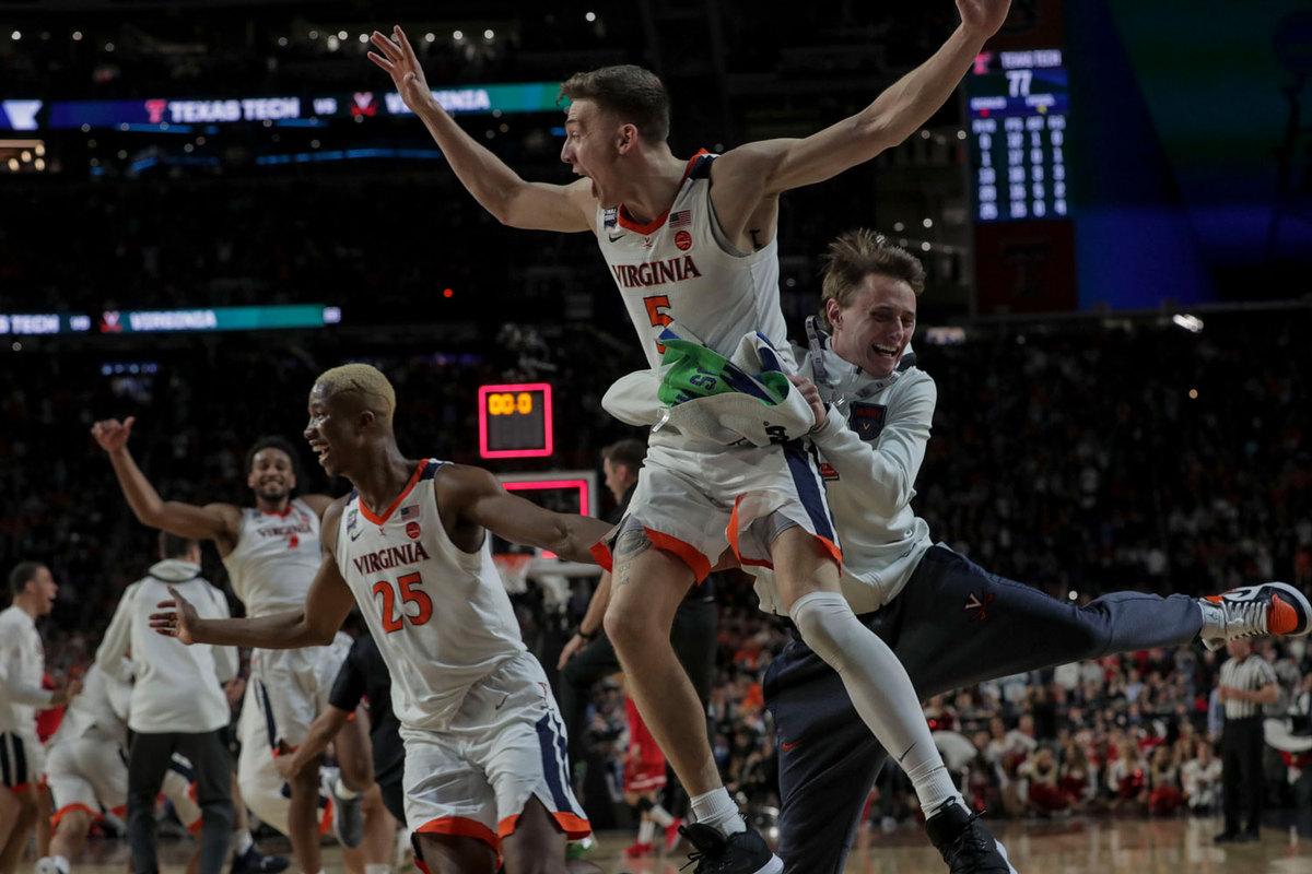 The UVA men's basketball team celebrates after winning the 2019 national championship. (Photo by Sanjay Suchak, University Communications)