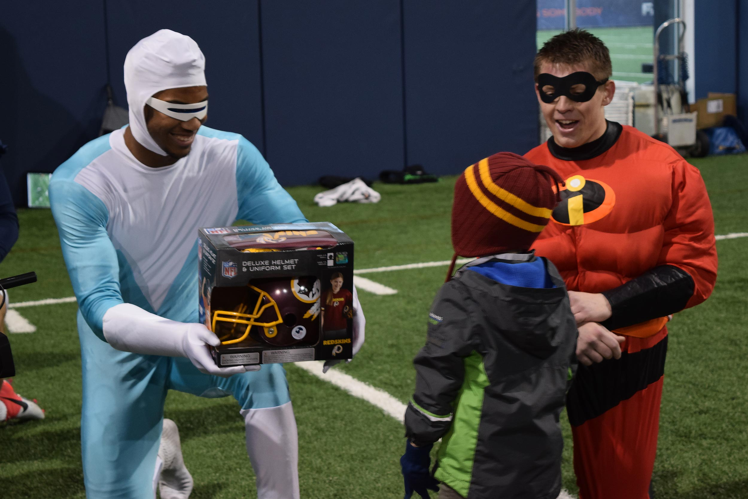"Snowden, left, dressed as Frozone from ""The Incredibles"" when children visited a UVA football practice last season."