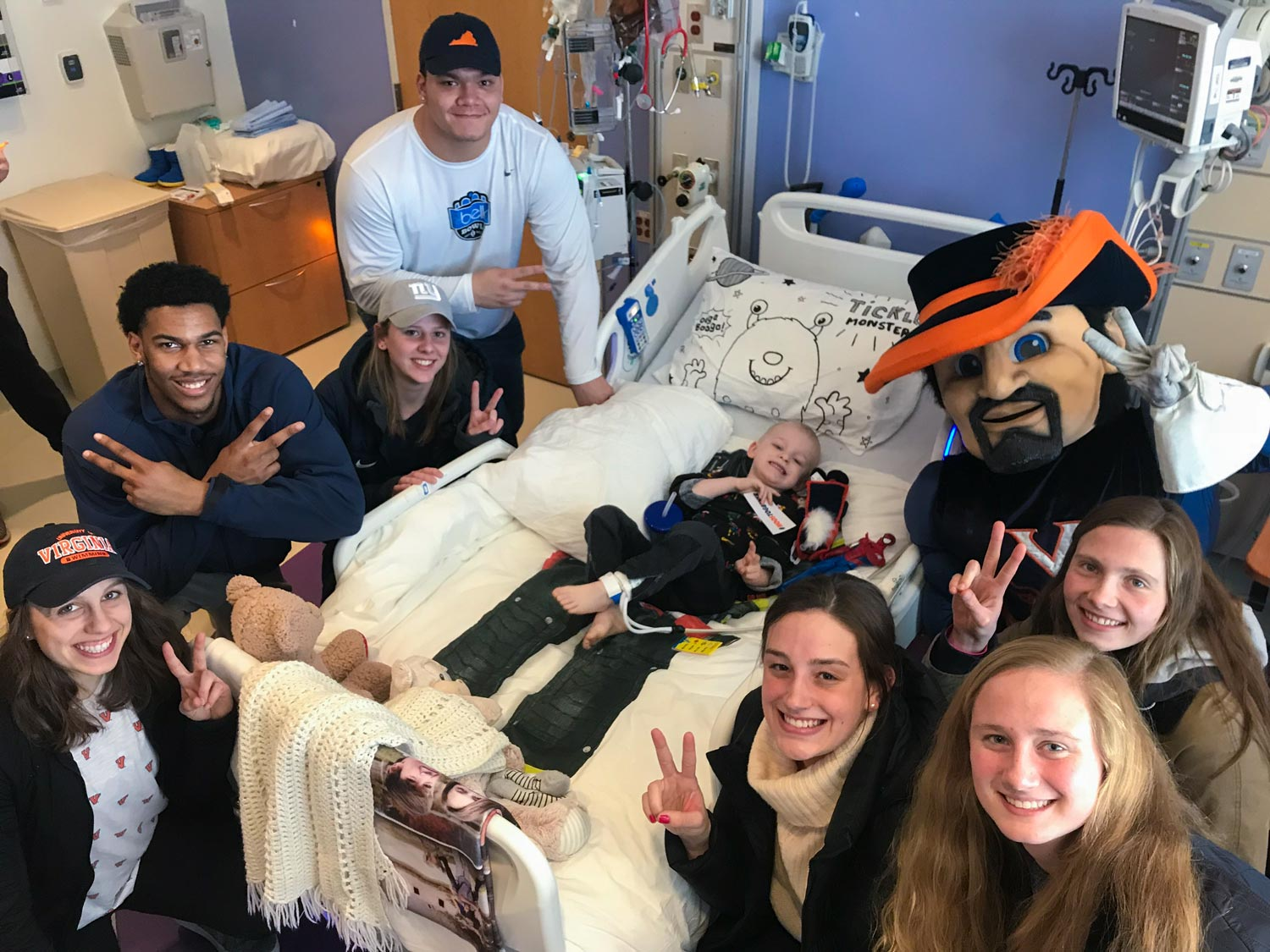 Snowden, second from left, making one of his many visits to UVA Children's Hospital.
