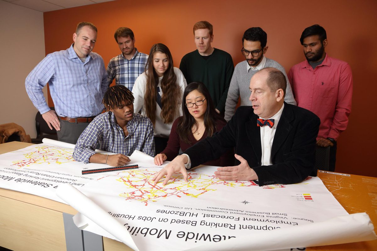 James H. Lambert, front right, a professor in the UVA Department of Engineering Systems and Environment, discusses freight corridors in Virginia with student researchers.