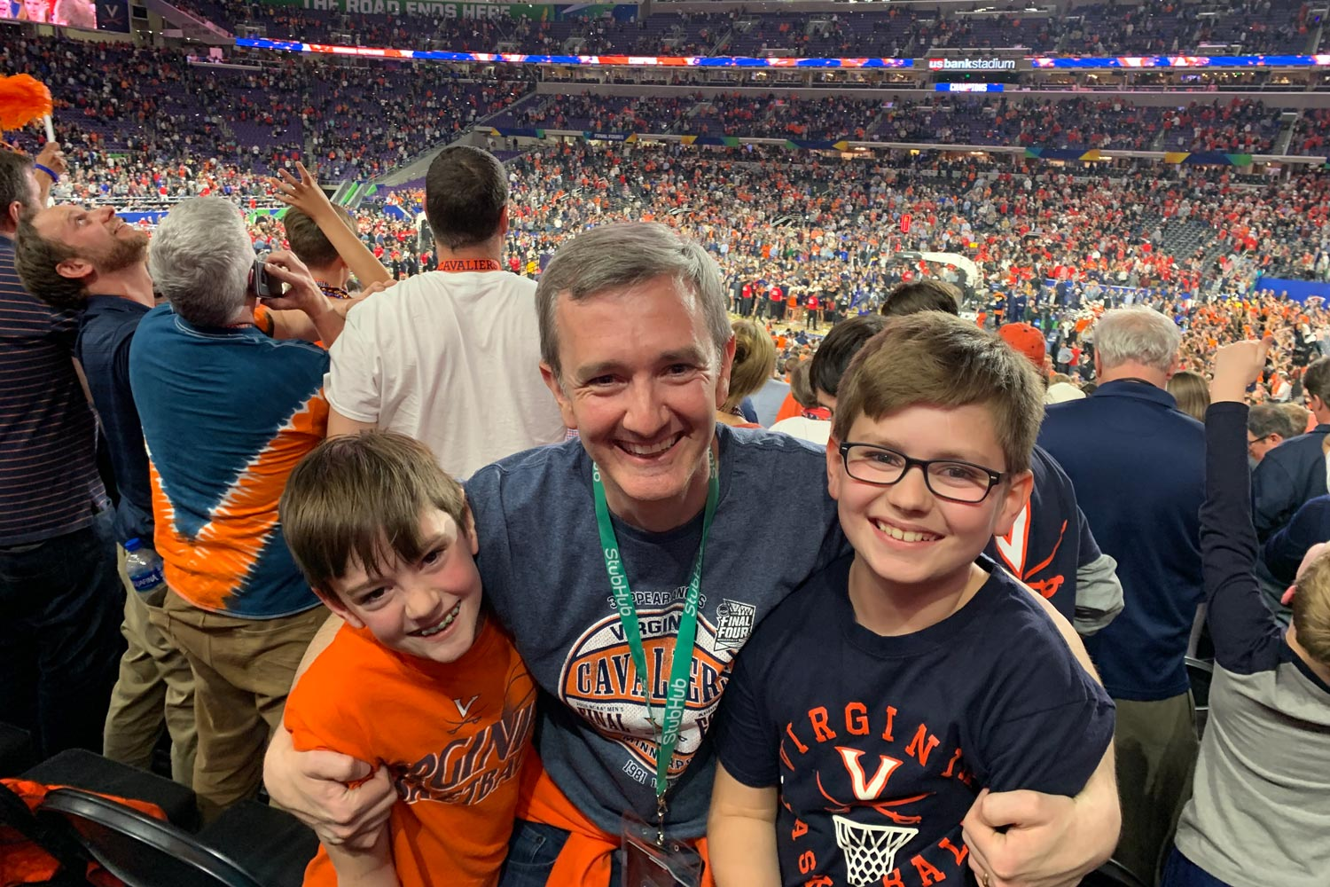 Alumnus Chris Duffy, center, and his sons James and Henry paused for a photo after the confetti rained down. (Contributed photo)