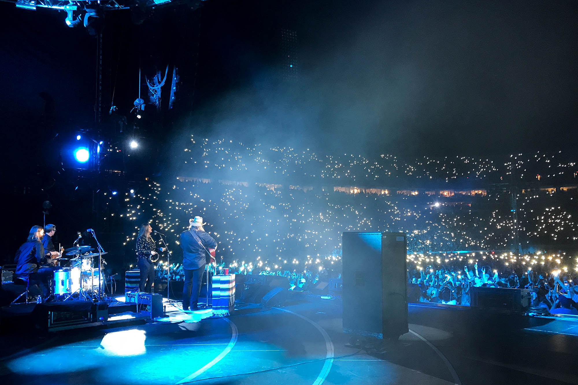 Chris Stapleton sings to a large stadium crowd