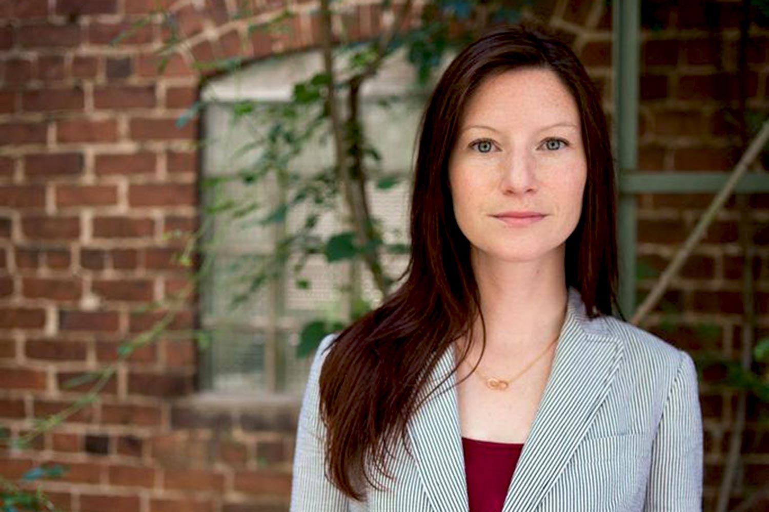 Batten professor Christine Mahoney received the Public Impact-Focused Research Award for her work supporting the rights of the displaced locally, nationally and globally. (Photo by Dan Addison, University Communications)