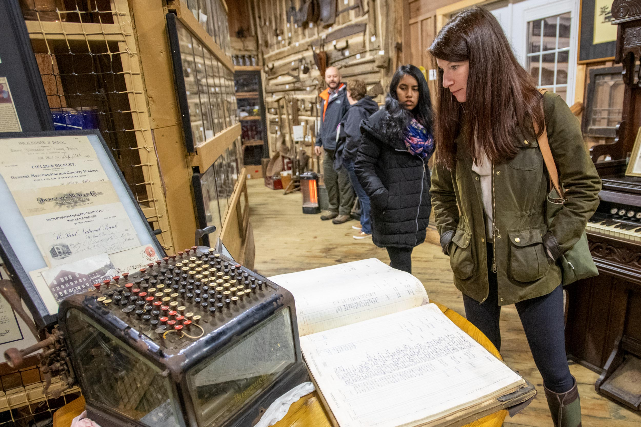 "Batten professor Christine Mahoney examines railroad and coal mining artifacts at the at the Mountain Heritage Museum in St. Paul, Virginia, during her January term course, ""Impact Investing in Action: Appalachia."""